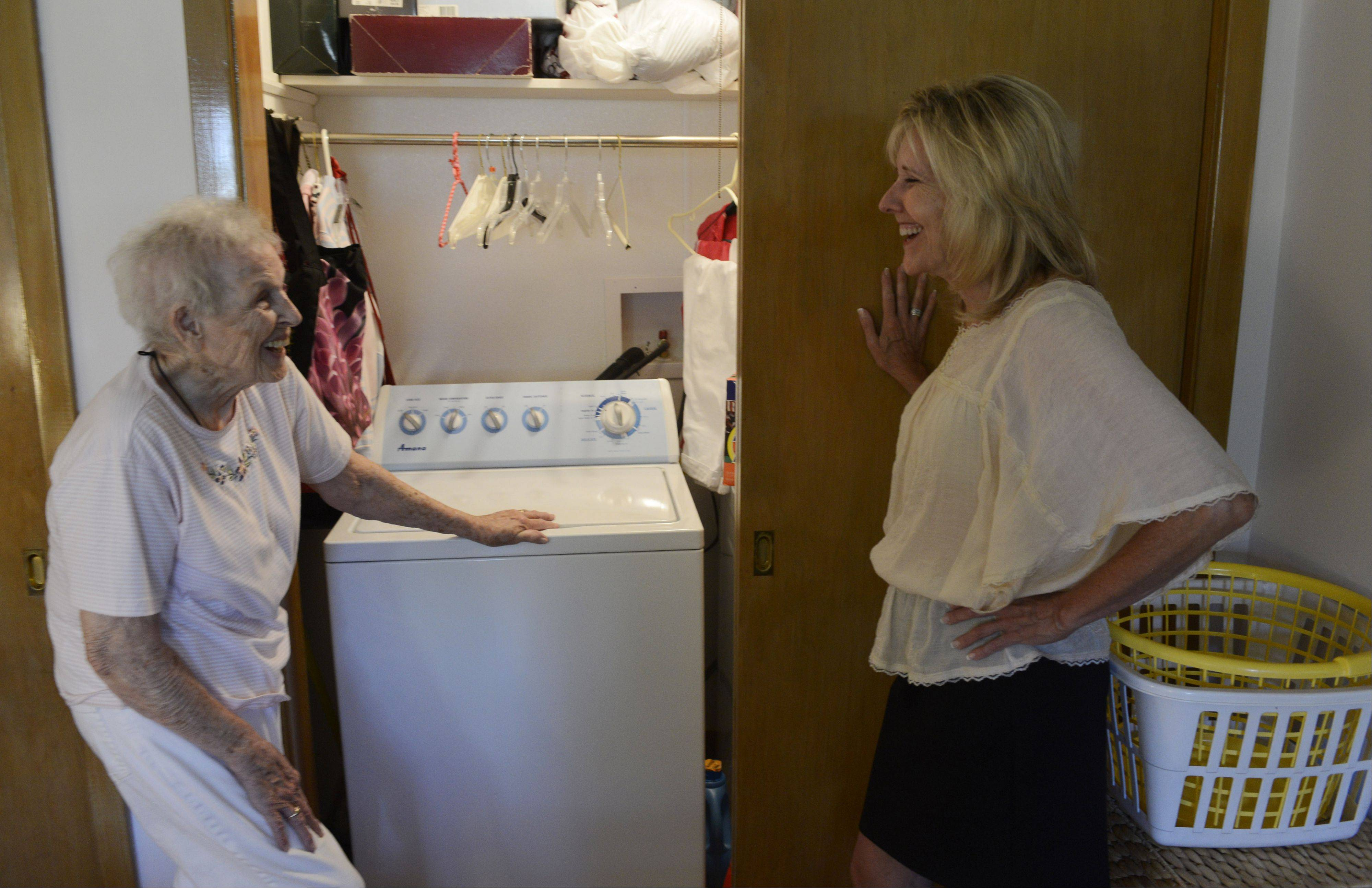 Margaret Fletcher of Des Plaines talks with her daughter-in-law, JoAnn Fletcher, as the two stand near a laundry room which was built into Margaret�s bedroom closet so she does not have to go into the basement. Angel Guardian, a Barrington-area business co-founded by JoAnn Fletcher, helps make seniors� homes safe to live in.