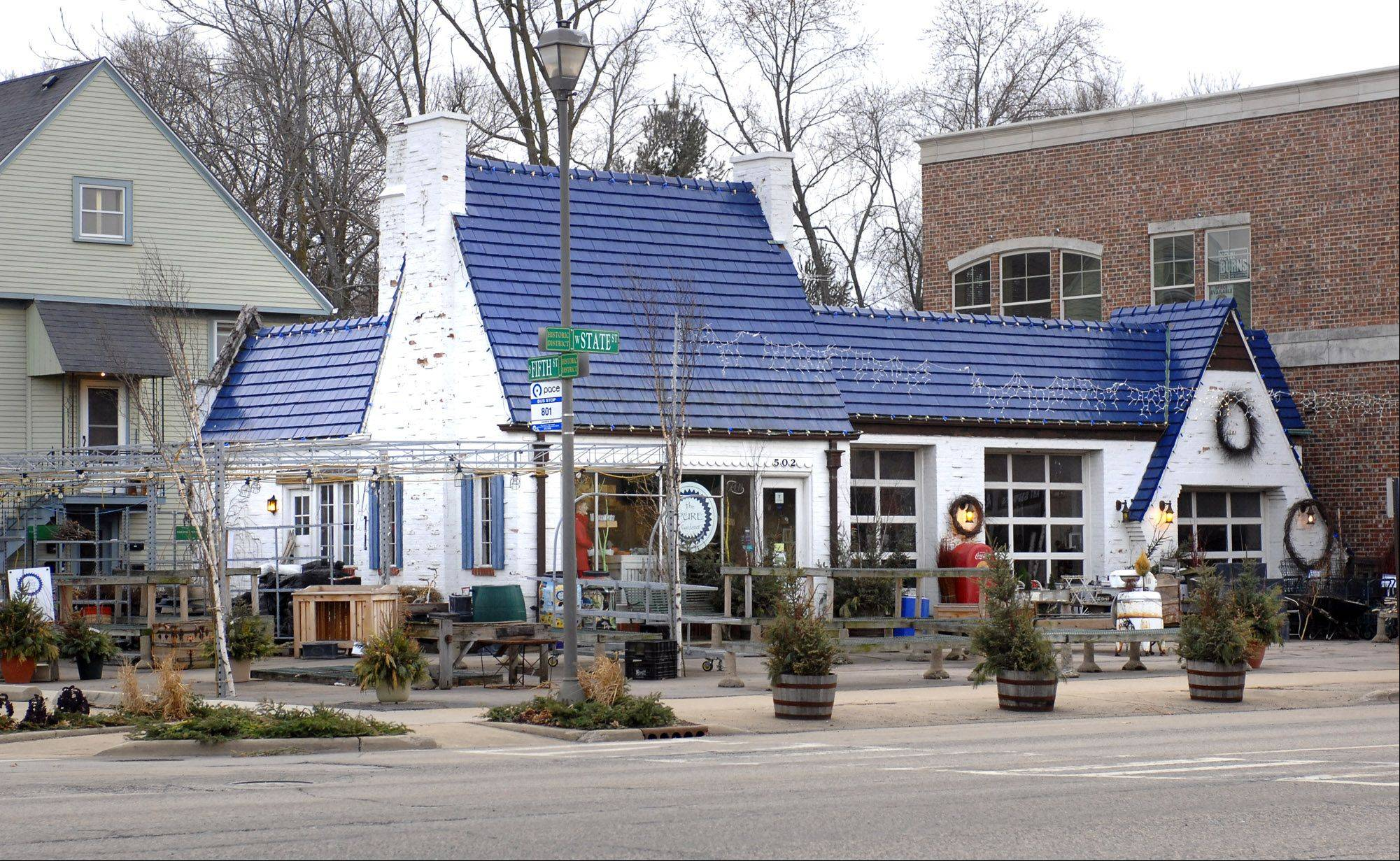 Before its renovation into a drive-up bank, this is how the old Pure Oil station in Geneva looked last year when it housed a gardening shop. Preservation Partners of the Fox Valley has won an award for advocating for the preservation of the historic building.