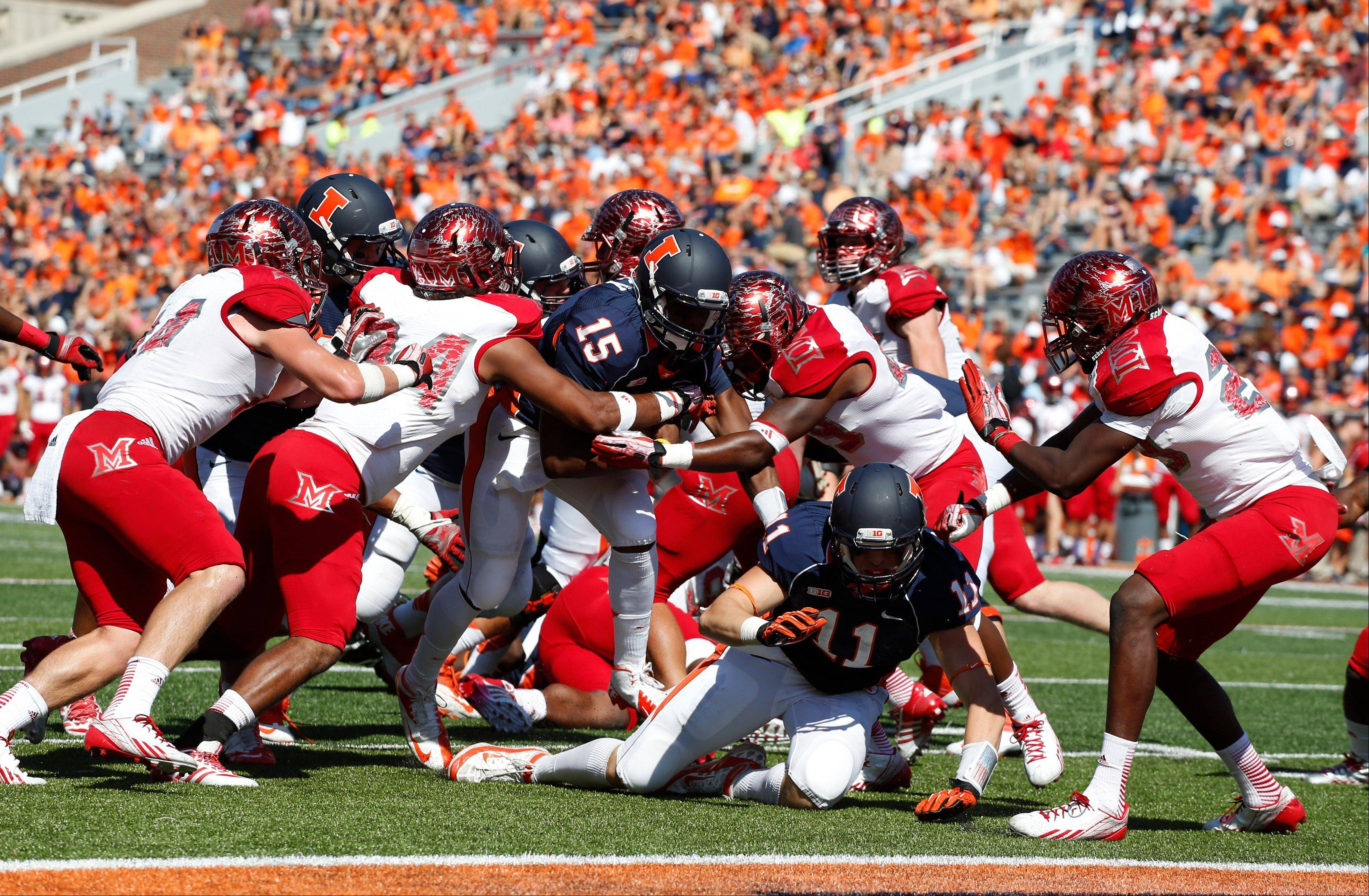 Illinois quarterback Aaron Bailey goes in for a touchdown against Miami (Ohio) during the second half of Saturday�s game at Memorial Stadium in Champaign.