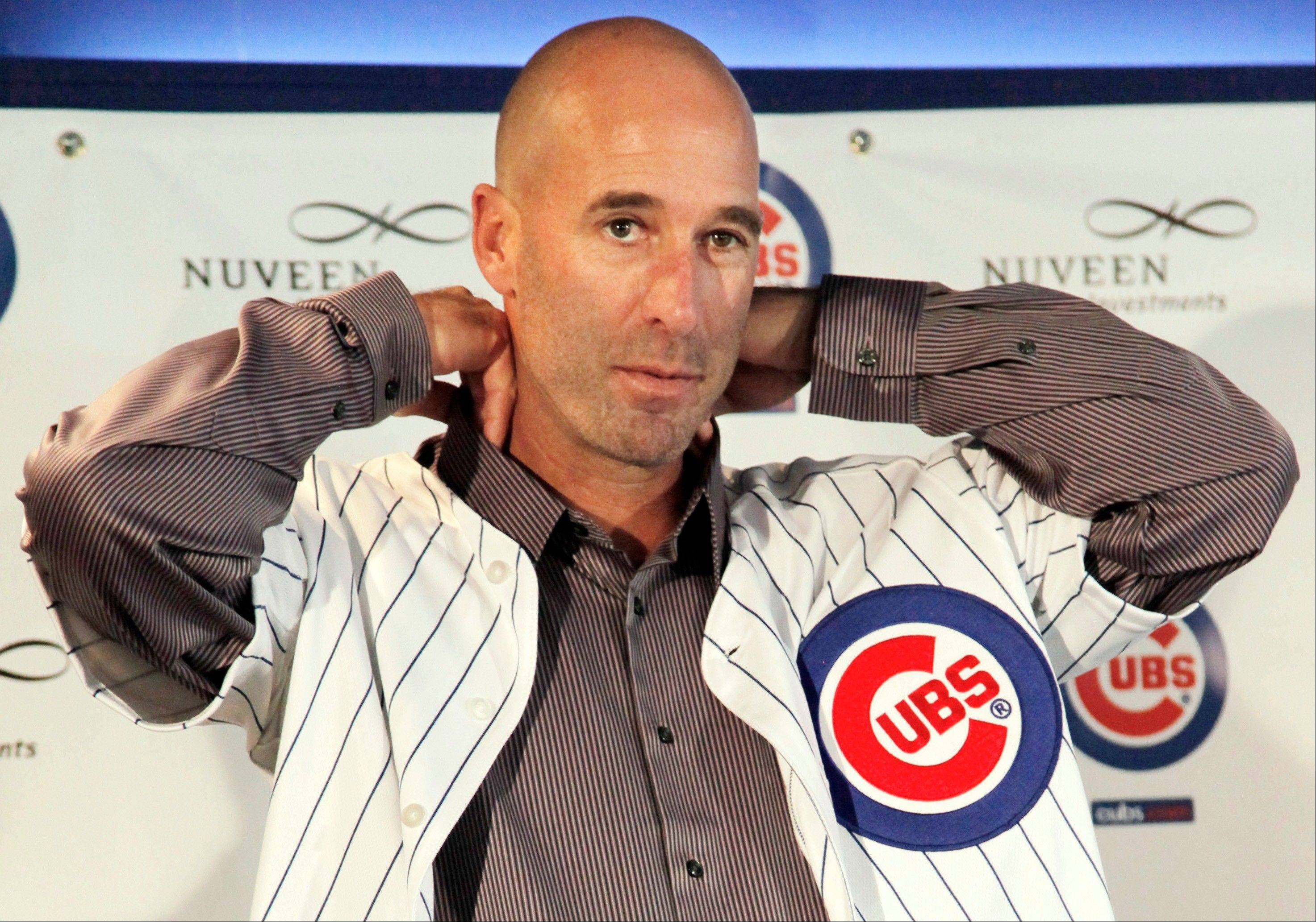Dale Sveum dons a Chicago Cubs jersey after being introduced as the new manager of the baseball club during a news conference, Friday, Nov. 18, 2011, in Chicago.