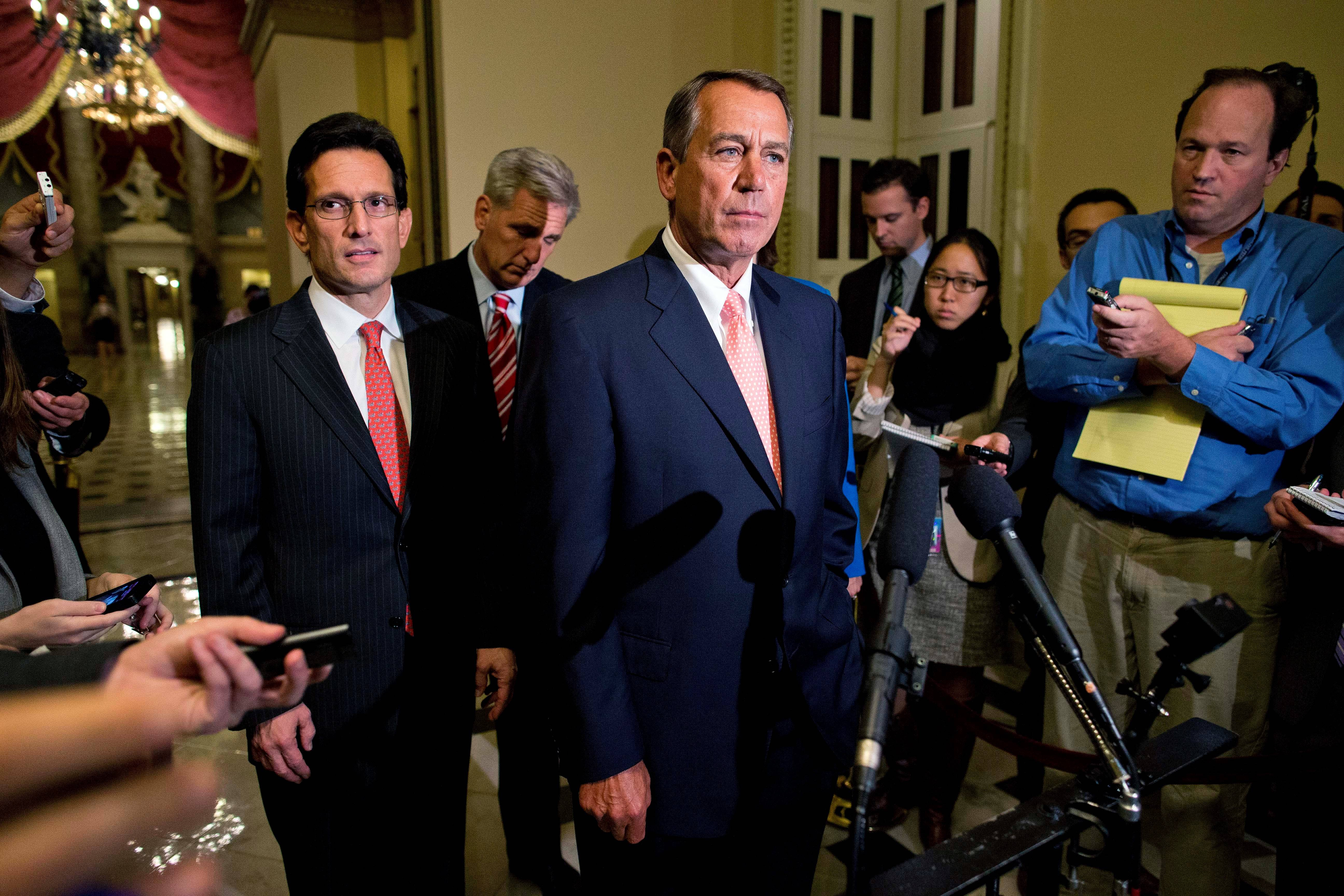 House Majority Leader Rep. Eric Cantor, R-Va., left, and House Majority Whip Rep. Kevin McCarthy, R-Calif., rear center, look on as Speaker of the House Rep. John Boehner, R-Ohio, pauses during a news conference on Capitol Hill  Tuesday.