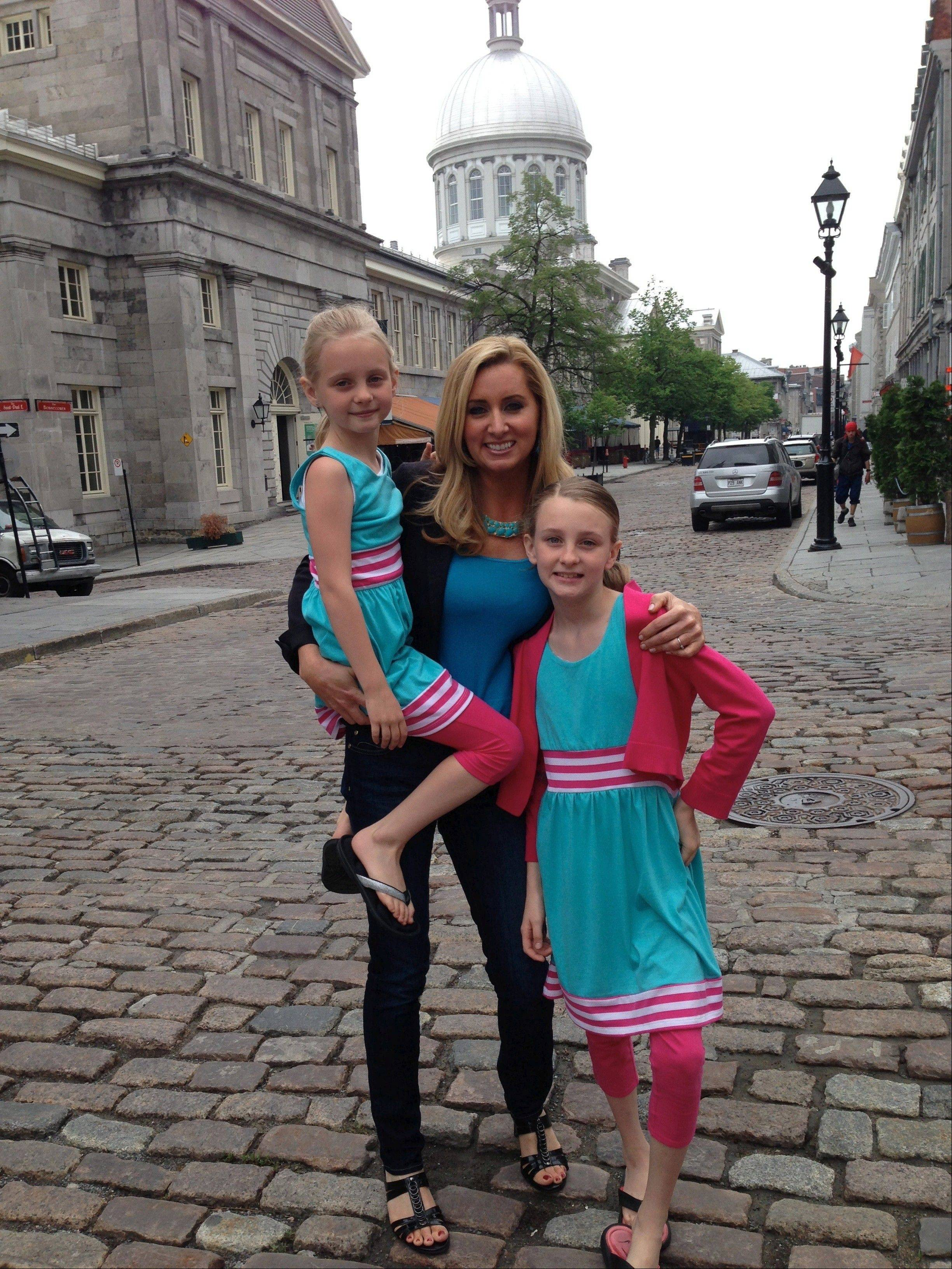 "Colleen Kelly, of Mount Prospect, poses with her daughters, Dunovan Kate, 11, and Shea Grace, 8, in Montreal while filming her new, national PBS show, ""Family Travel with Colleen Kelly."""
