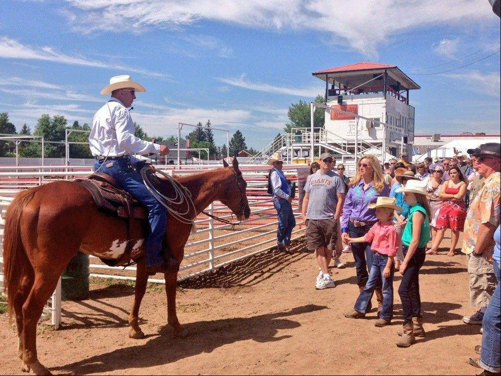 "Colleen Kelly, of Mount Prospect, visits a Wyoming rodeo while filming her new national PBS series, ""Family Travel with Colleen Kelly."""
