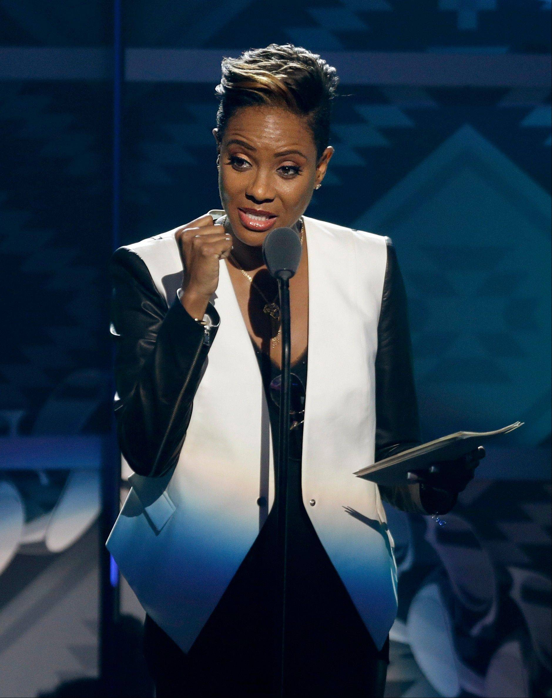 "Rapper MC Lyte accepts the ""I Am Hip Hop Award"" during the BET Hip Hop Awards Saturday in Atlanta."