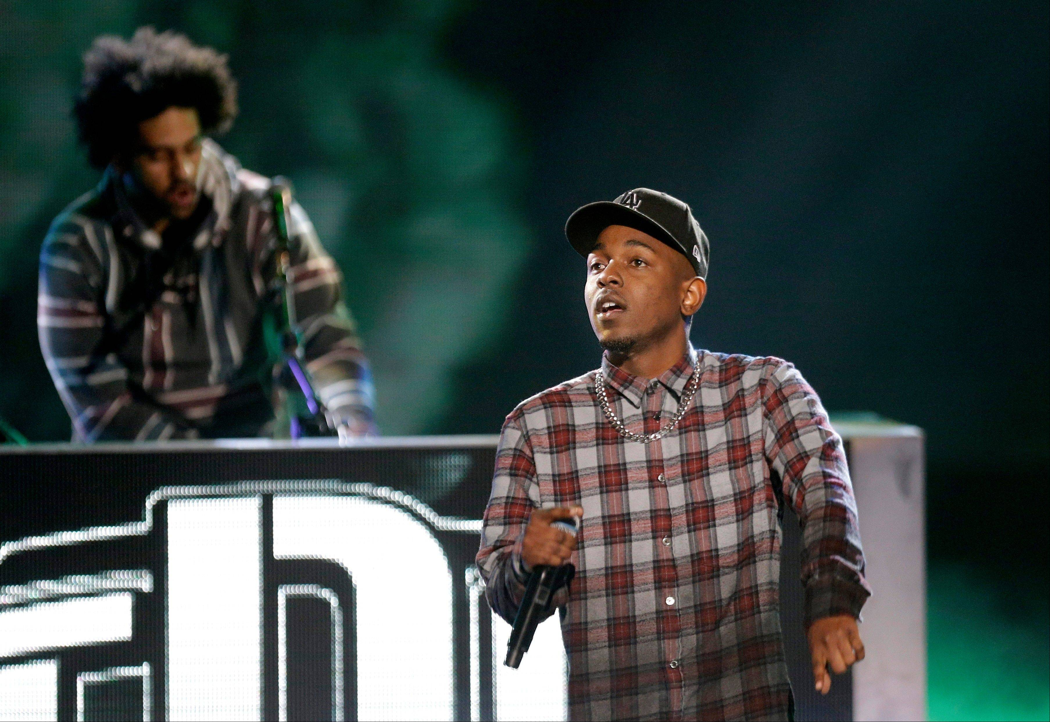 Rapper Kendrick Lamar, right, performs at the BET Hip Hop Awards, Saturday. The show airs on Oct. 15.