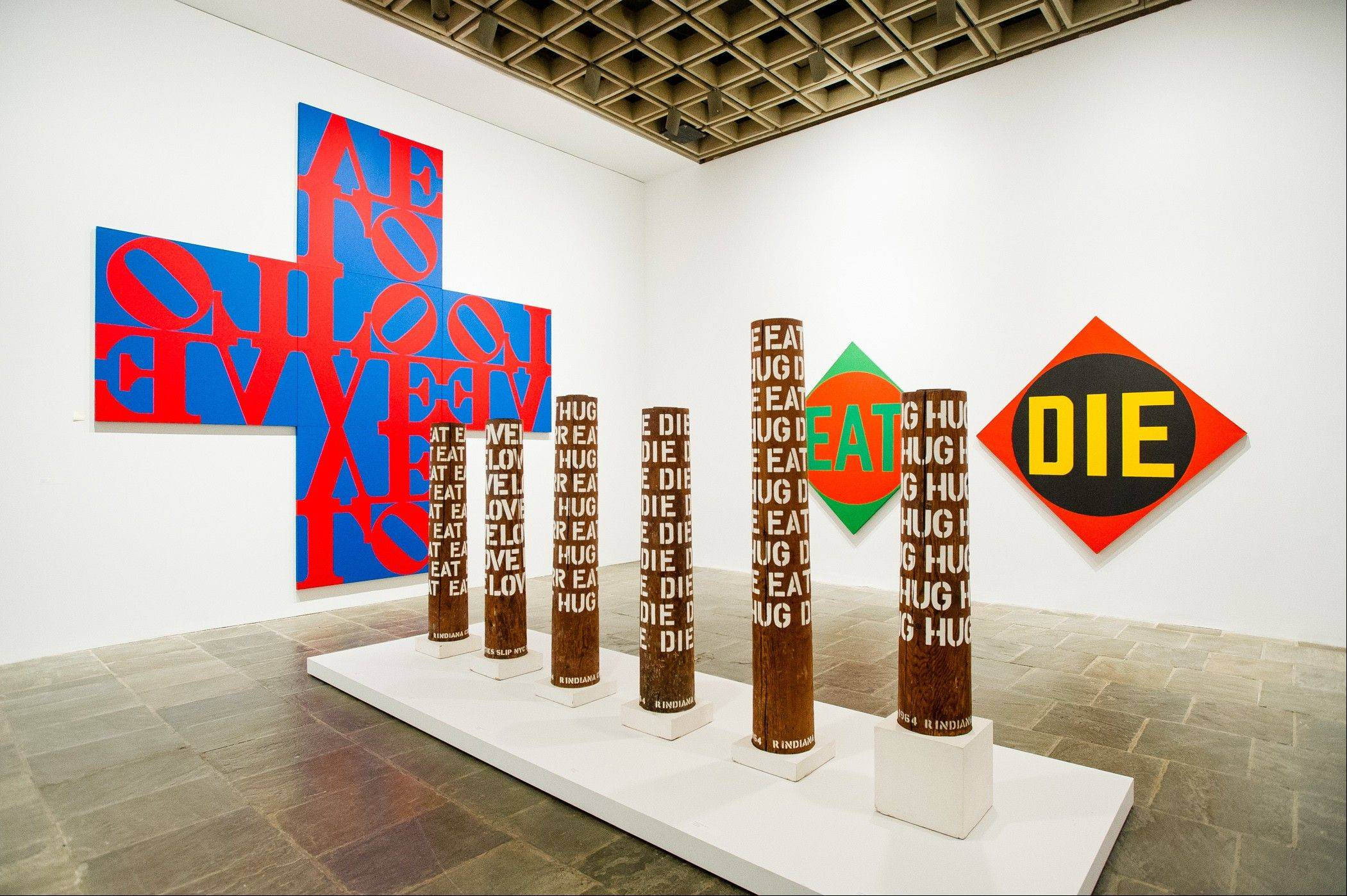 In the Robert Indiana exhibition in New York, there's a LOVE painting in the form of a cross and a small aluminum model that served as a template for all his other LOVE pieces.