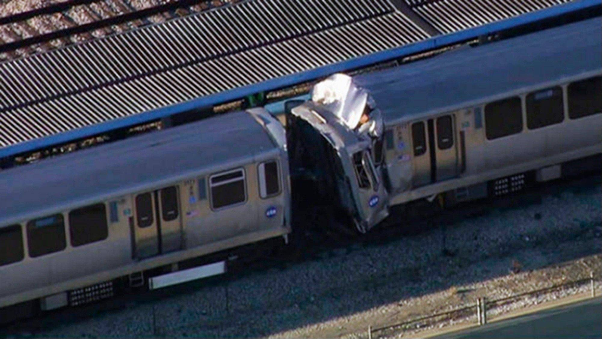 This image from video provided by NBC Chicago shows the aftermath of a crash involving two Chicago Transit Authority trains on the Blue Line during rush hour Monday.