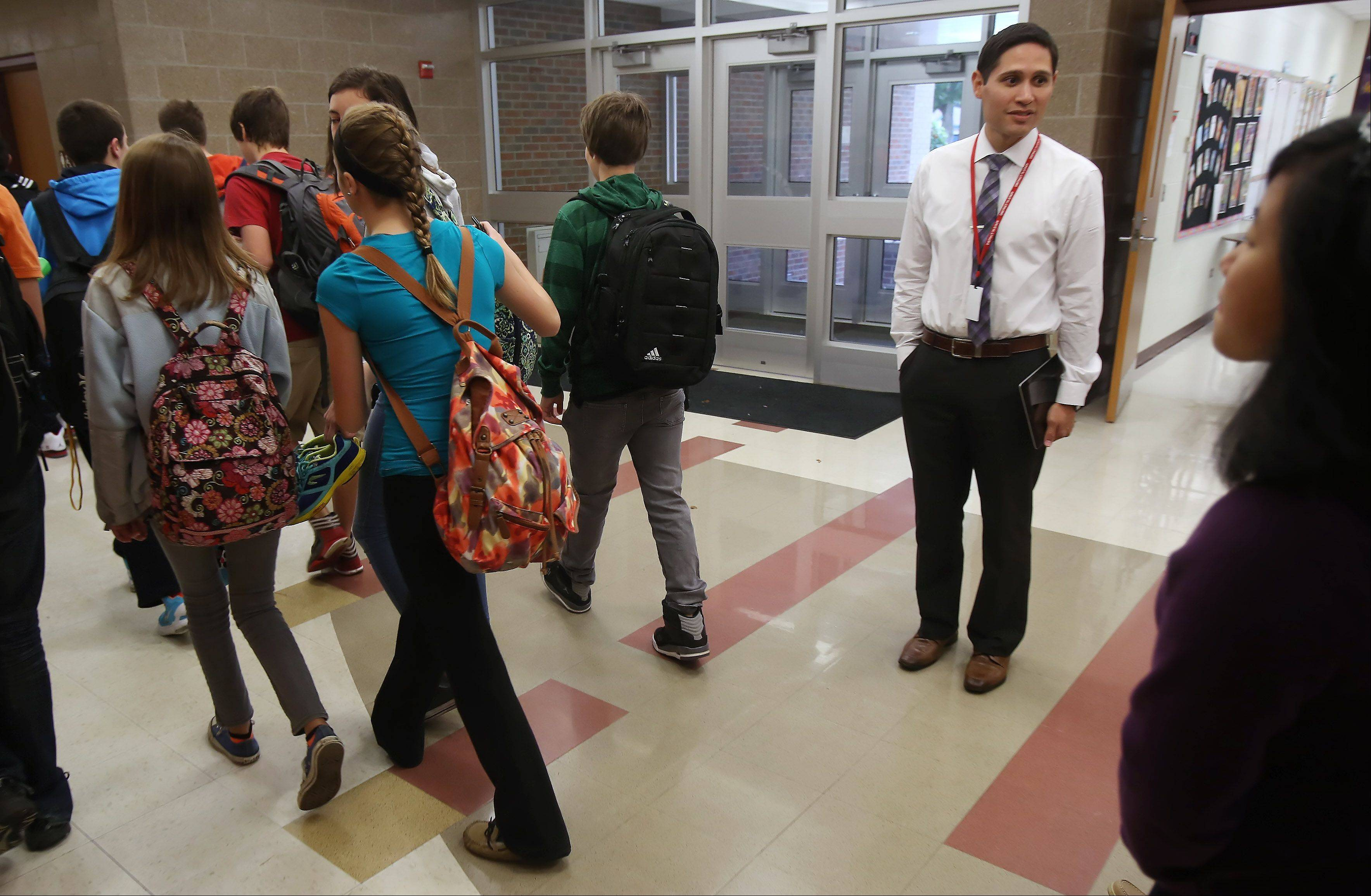 Highland Middle School Assistant Principal Lorenzo Cervantes talks to students as they switch classes. Cervantes has been involved with the new online bullying forms at the Libertyville school. Online forms allow students and parents report bullying to school officials and have helped Lake County school districts deal with a problem that has been in the national spotlight.