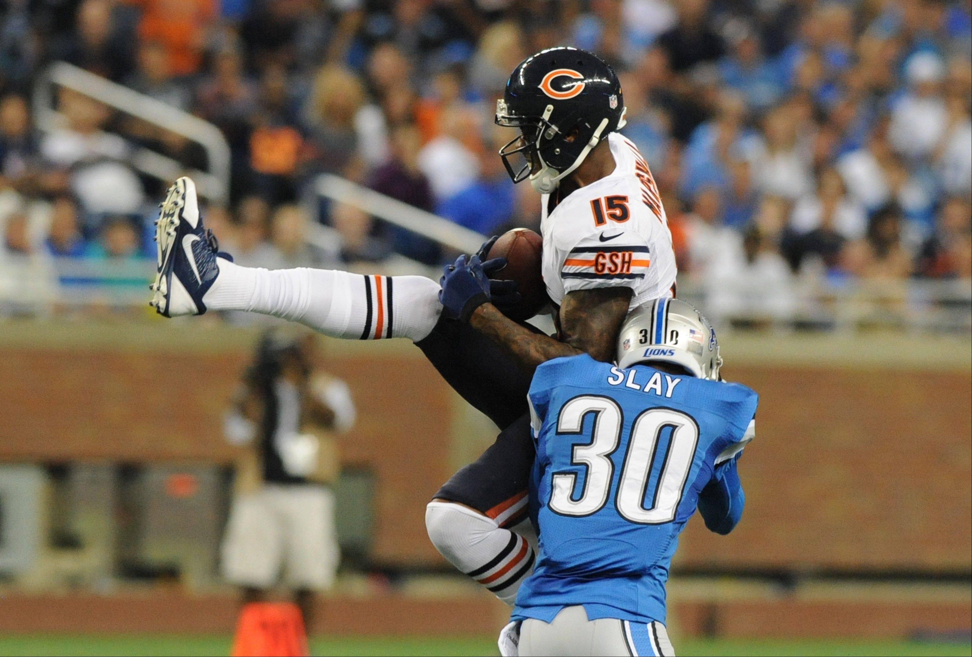 Chicago Bears wide receiver Brandon Marshall (15) is stopped by Detroit Lions cornerback Darius Slay (30) after a 24-yard reception during the third quarter of an NFL football game Sunday at Ford Field in Detroit.