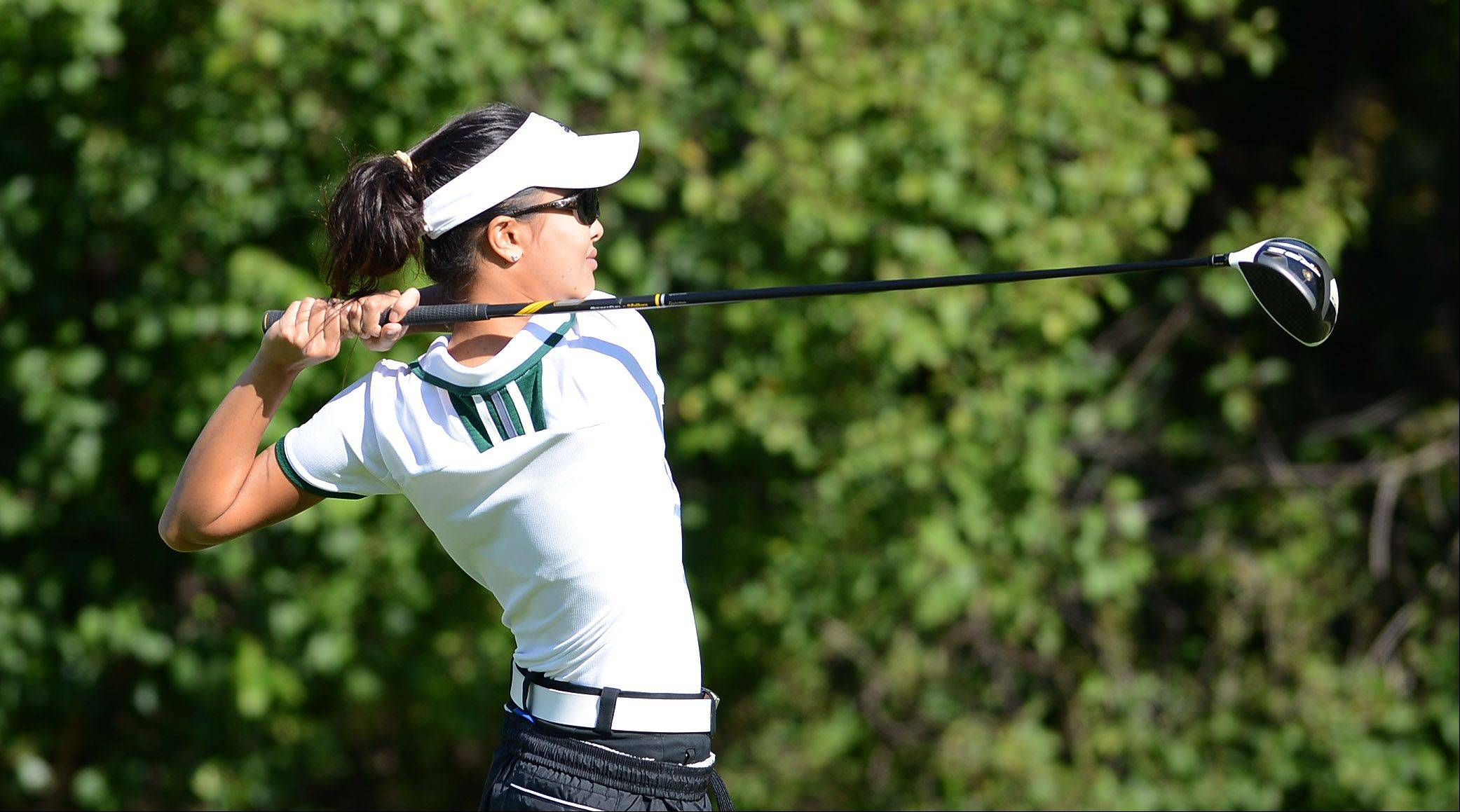 Bing Singhsumalee of Waubonsie Valley drives off the tee during Monday's Upstate Eight girls golf conference meet in West Chicago.