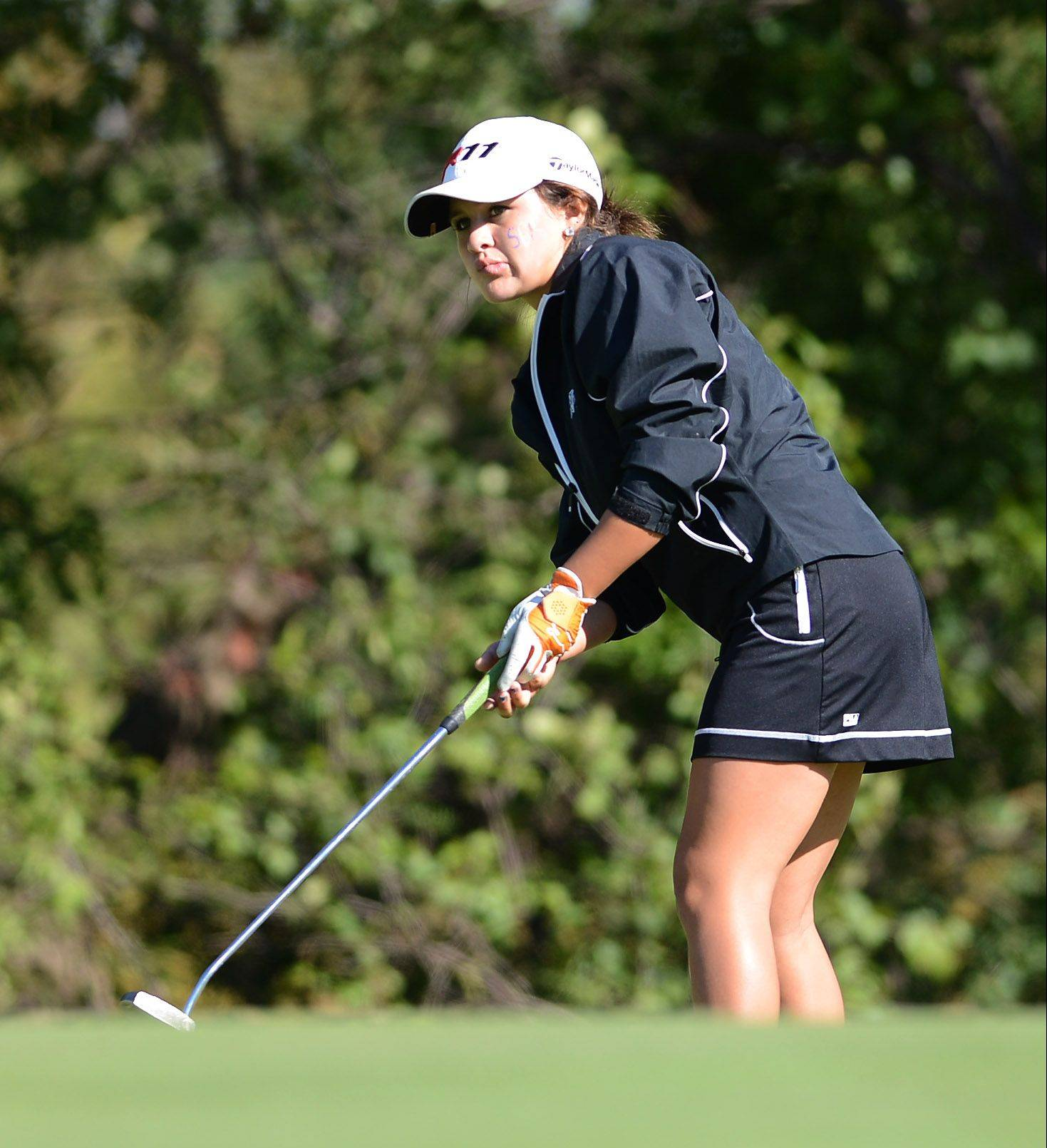 St. Charles North's Gianna Furrie watches her putt during Monday's Upstate Eight Conference meet in West Chicago.