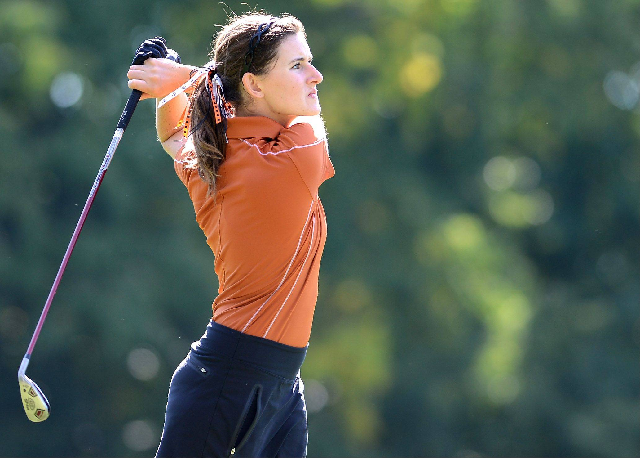 St. Charles East's Darby Crane tees off during Monday's Upstate Eight meet in West Chicago.