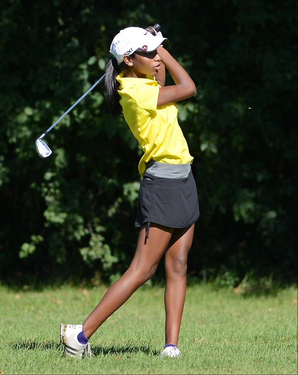 Metea Valley's Niquole Mangal hits from the short rough during Monday's Upstate Eight meet in West Chicago.