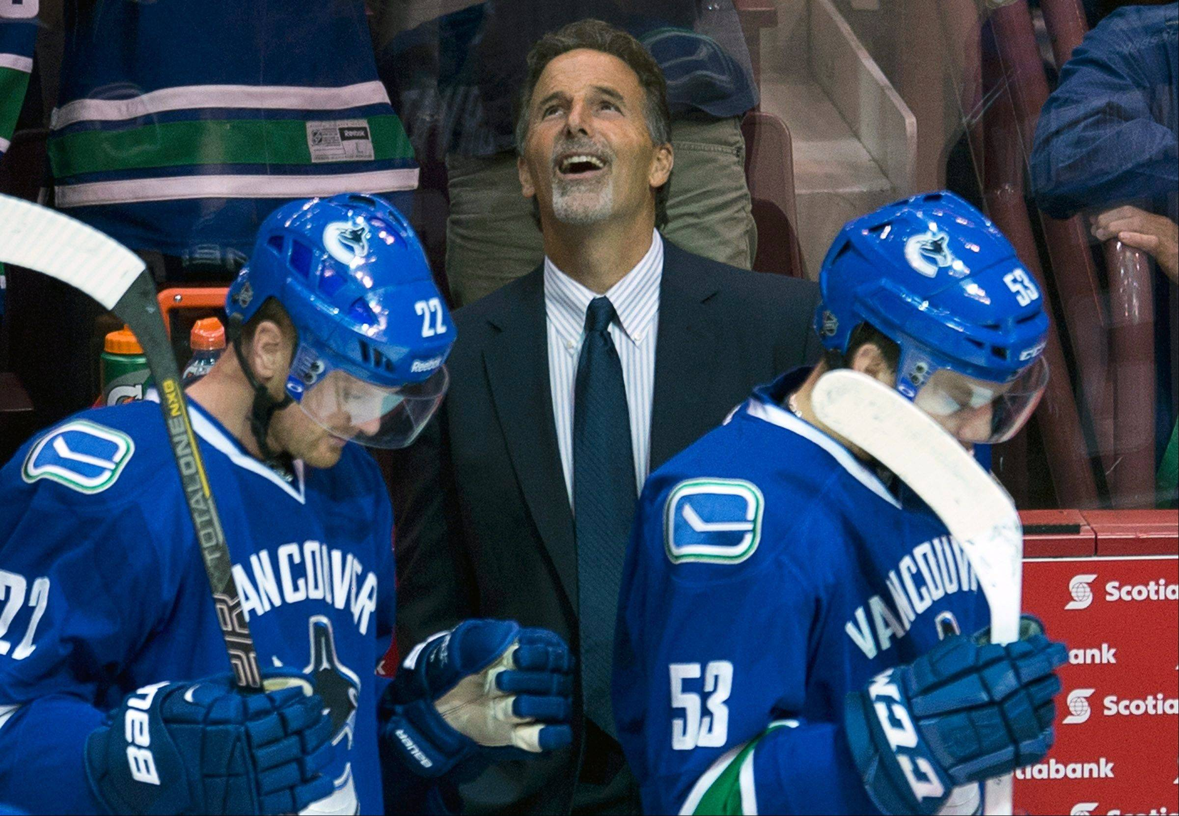Keeping goalie Roberto Luongo and trading Cory Schneider will make Vancouver head coach John Tortorella's job more difficult. Even though he's smiling here, Tortorella's critics believe his tough-guy act will wear thin in Canada.