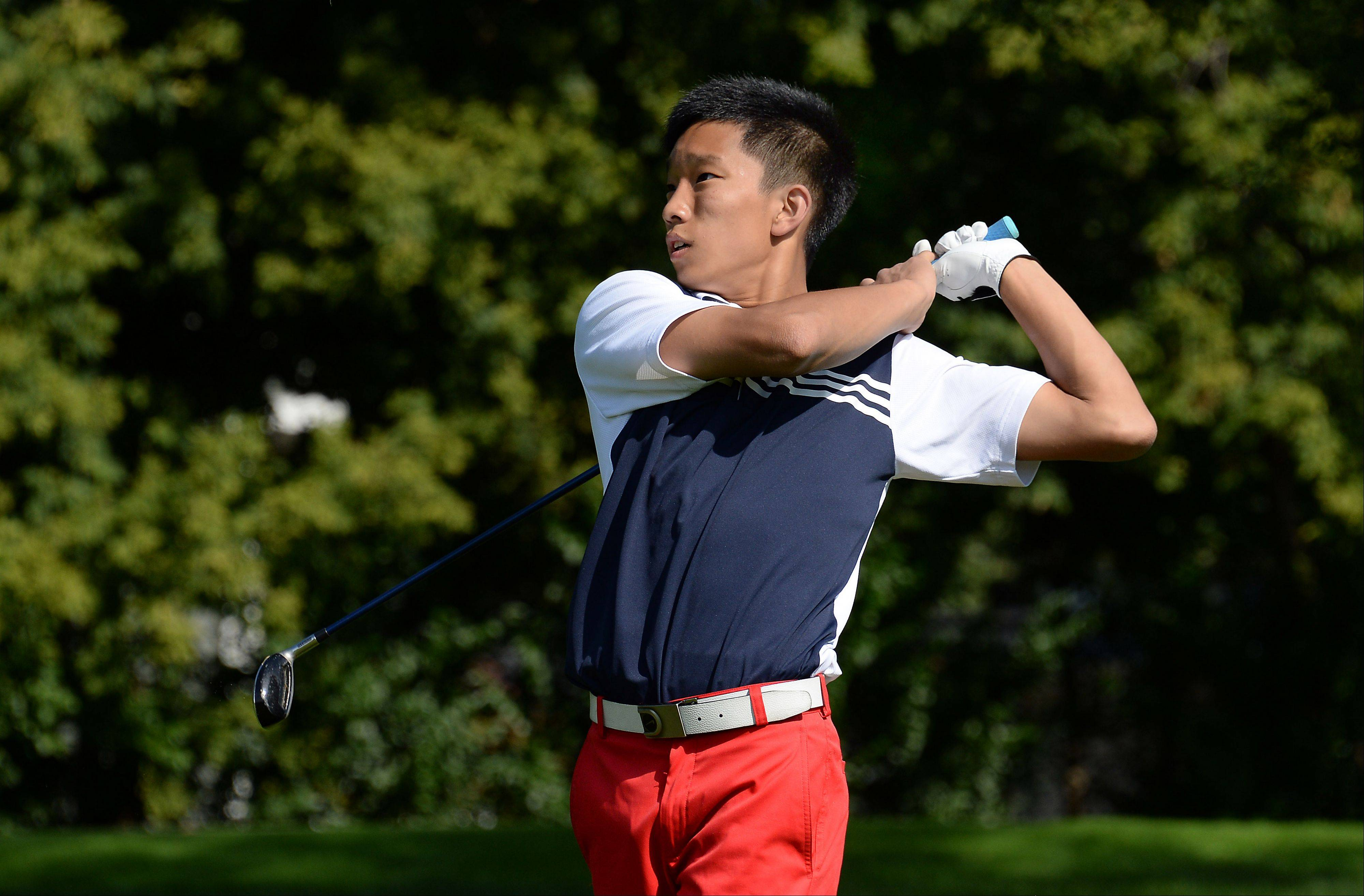 Conant's Jon Chang watches the flight of his drive on No. 8 during the Mid-Suburban League championship at Schaumburg Golf Club on Monday.