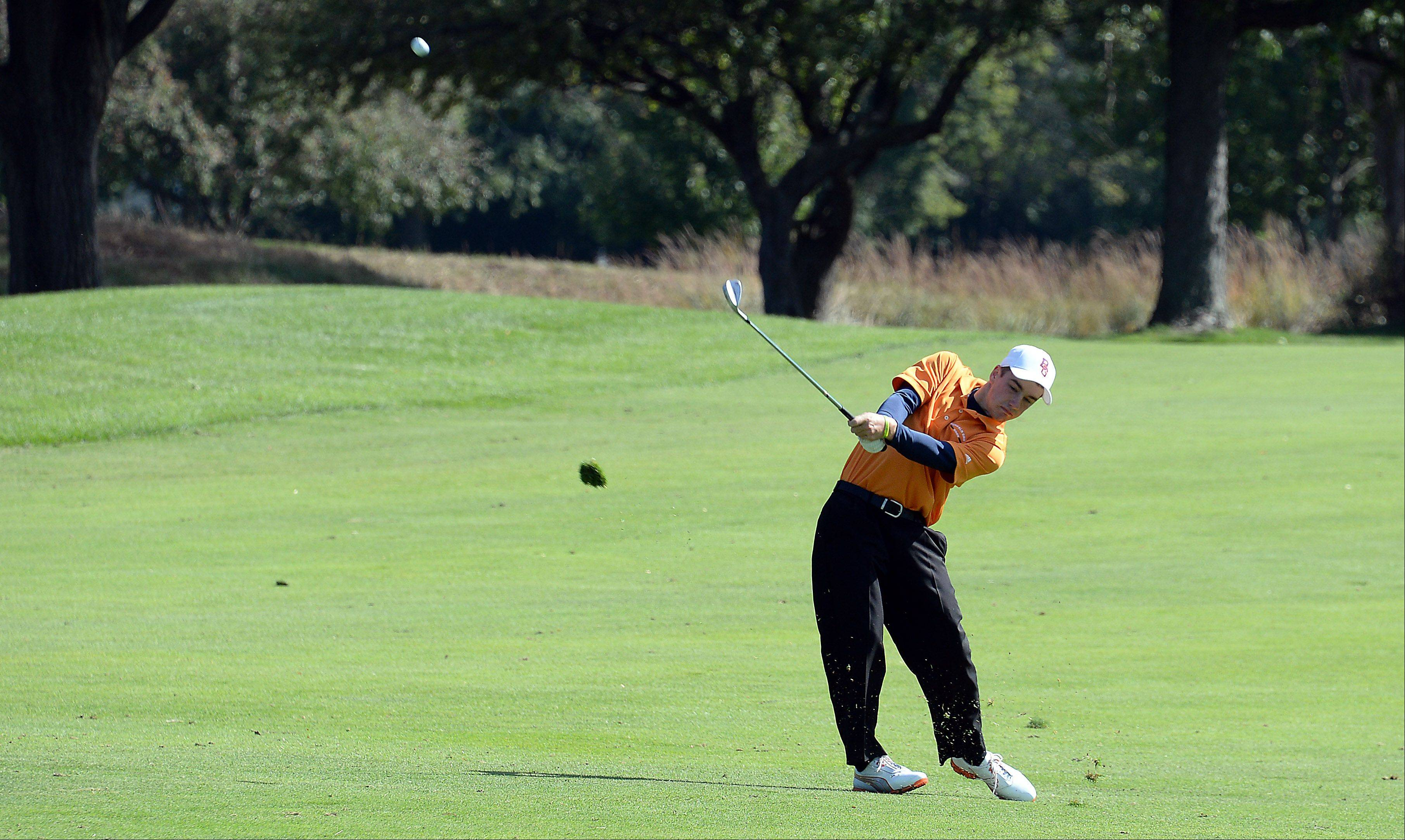 Buffalo Grove's Brandon Matchen drives down the fairway on No. 7 during the Mid-Suburban League championship at Schaumburg Golf Club on Monday.