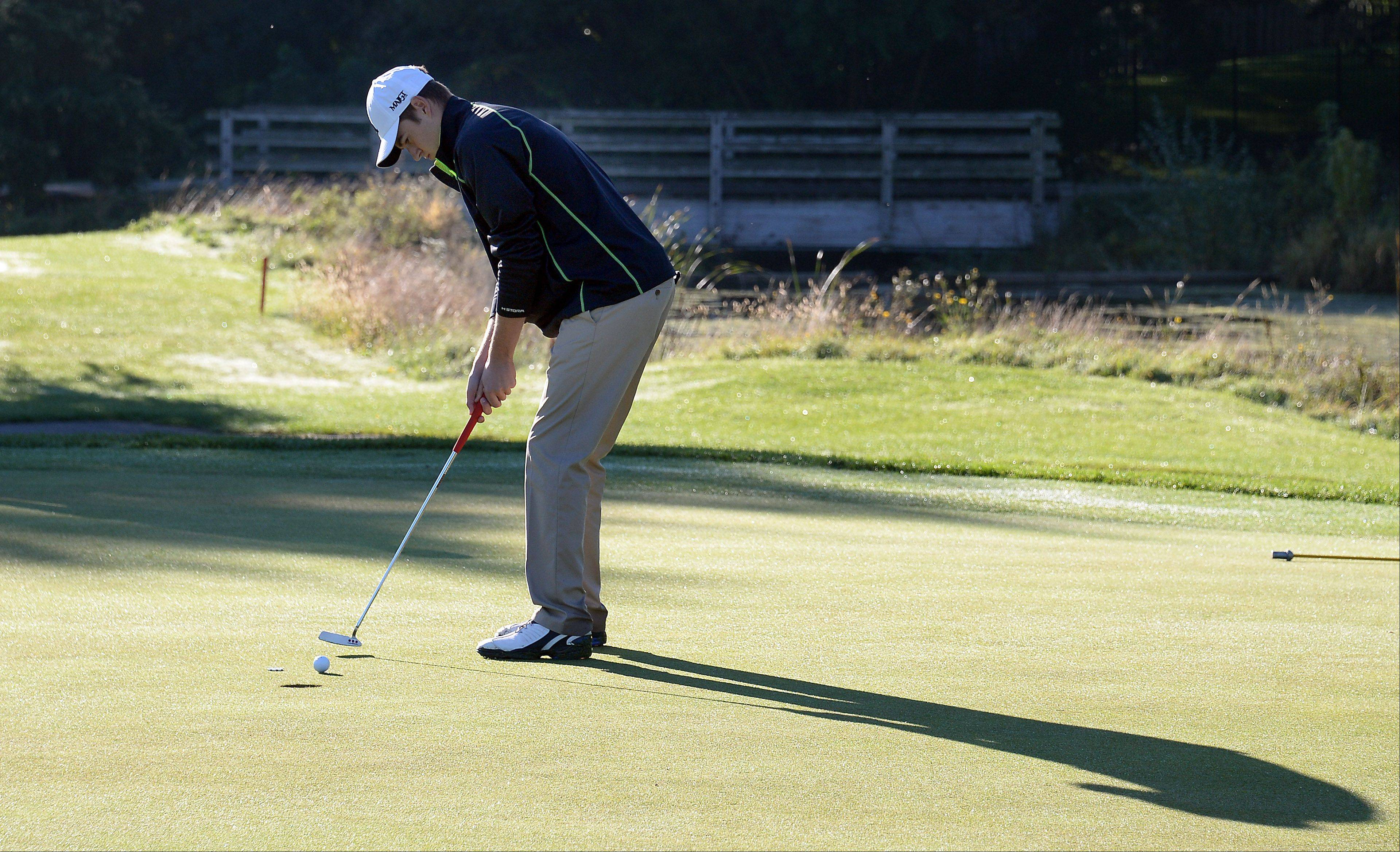 Fremd's Jamie Drost putts on No. 19 during the Mid-Suburban League championship at Schaumburg Golf Club on Monday.