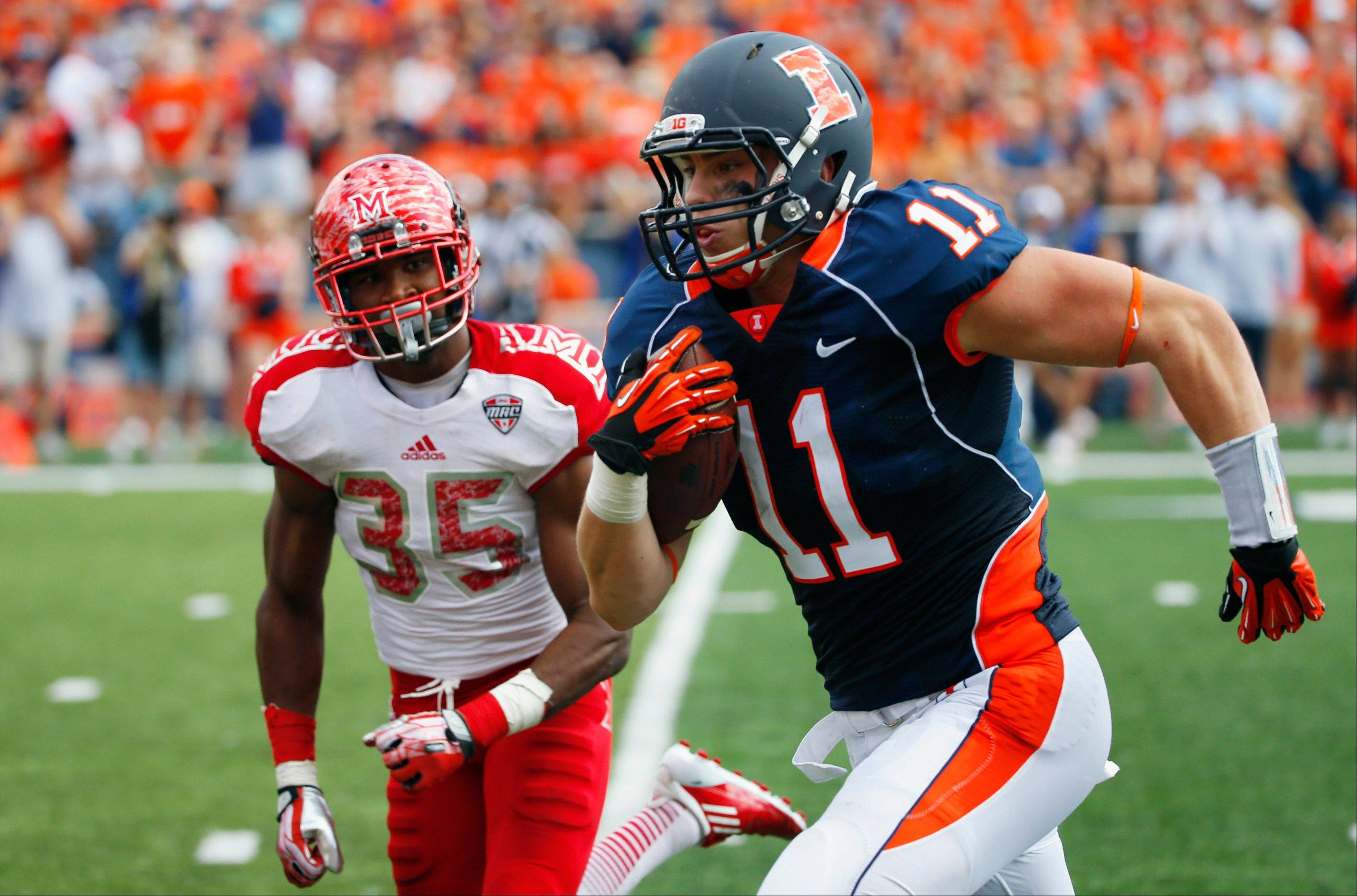 Illinois tight end Matt LaCosse runs in for a touchdown past Miami (Ohio) defensive back Brison Burris during Saturday's big win in Champaign.
