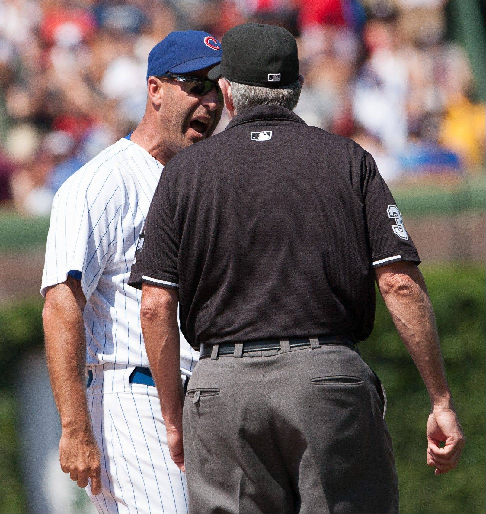 Chicago Cubs manager Dale Sveum, left, argues with first base umpire Mike Winters before being tossed from a baseball game against the St Louis Cardinals in Chicago, Saturday, July 28, 2012.