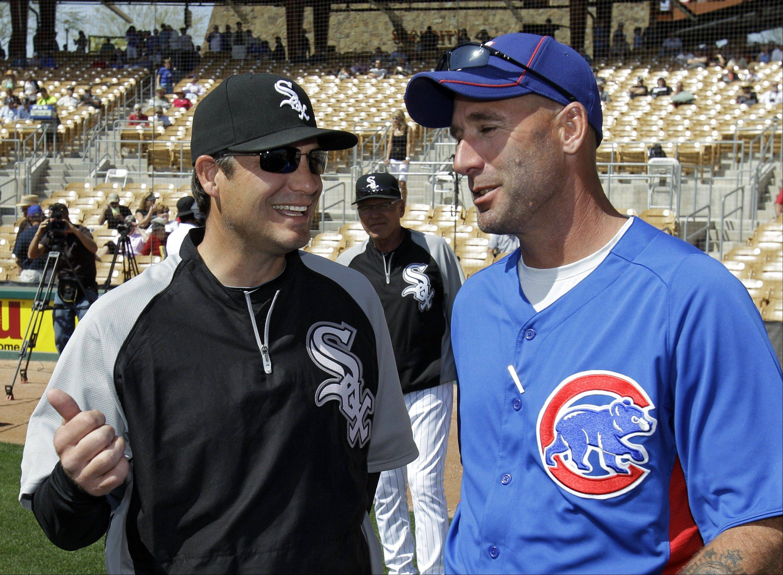 Chicago White Sox manager Robin Ventura, left, talks with Chicago Cubs manager Dale Sveum before a spring training baseball game Friday, March 9, 2012, in Glendale, Ariz.