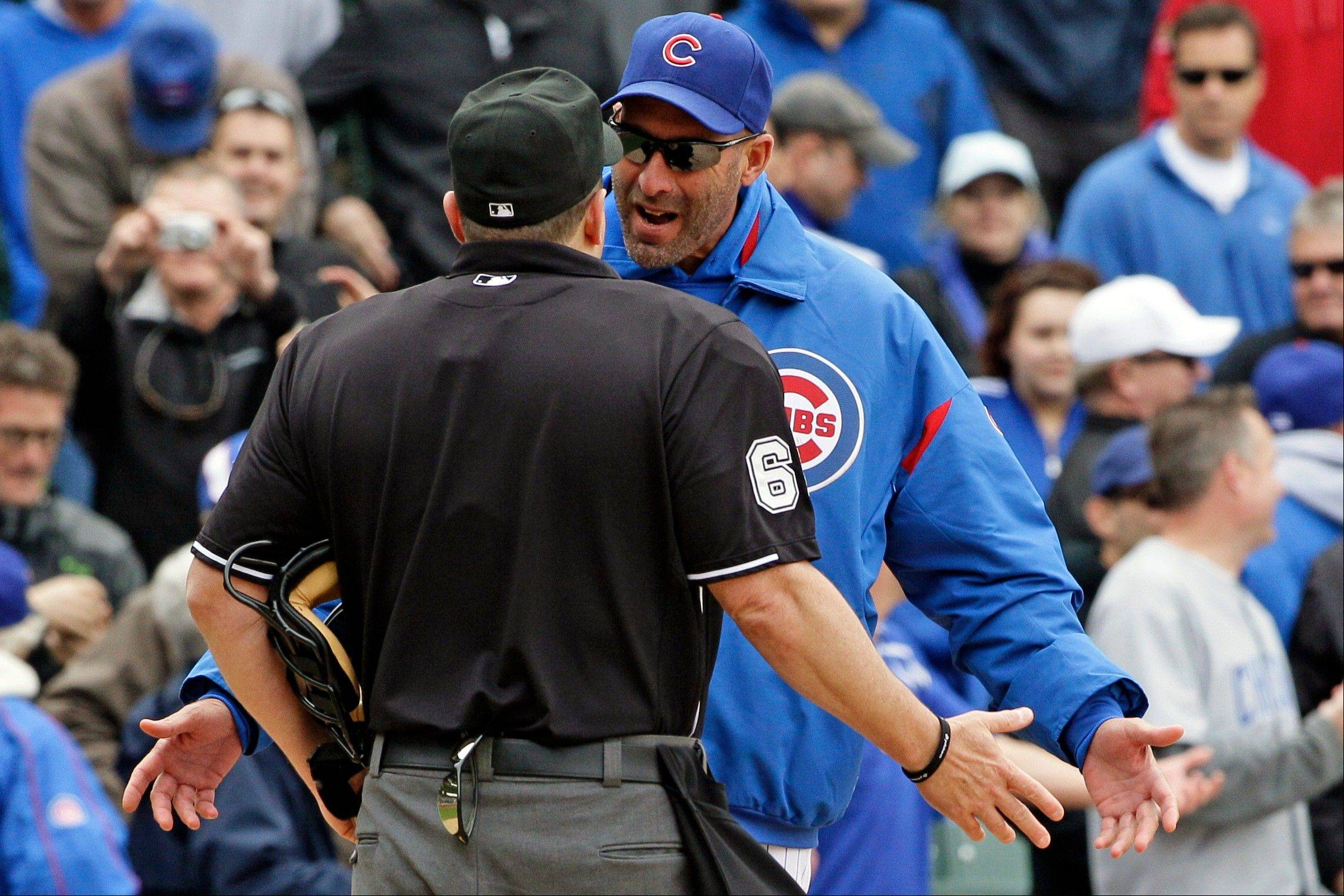 Chicago Cubs manager Dale Sveum, right, argues with home plate umpire Marty Foster during the ninth inning of a baseball game against the Los Angeles Dodgers in Chicago, Friday, May 4, 2012. The Cubs won 5-4.