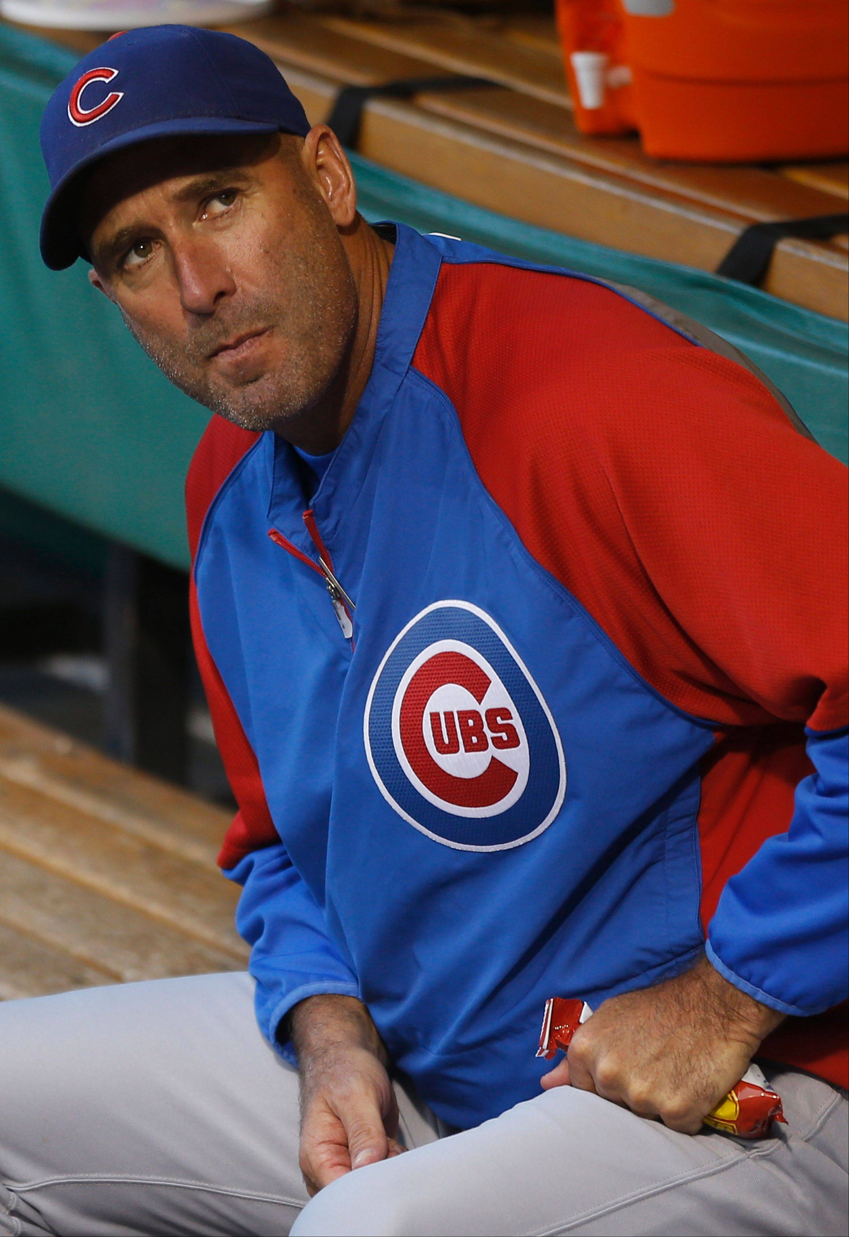 Chicago Cubs manager Dale Sveum looks from the dugout before the baseball game against the Pittsburgh Pirates on Friday, Sept. 13, 2013, in Pittsburgh. The Cubs won 5-4.
