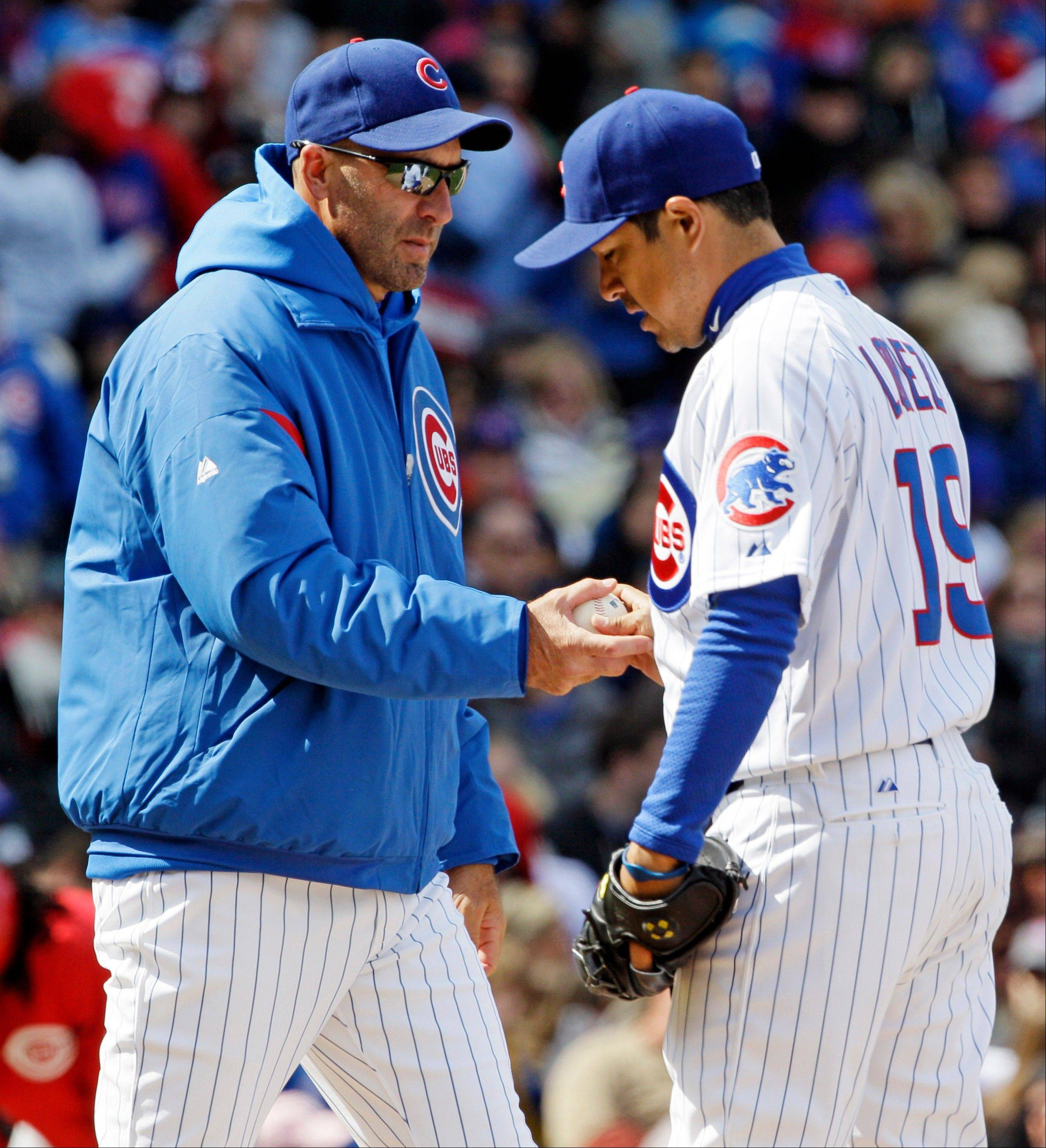 Chicago Cubs manager Dale Sveum, left, takes the ball from relief pitcher Rodrigo Lopez during the sixth inning of a baseball game against the Cincinnati Reds in Chicago, Sunday, April 22, 2012.