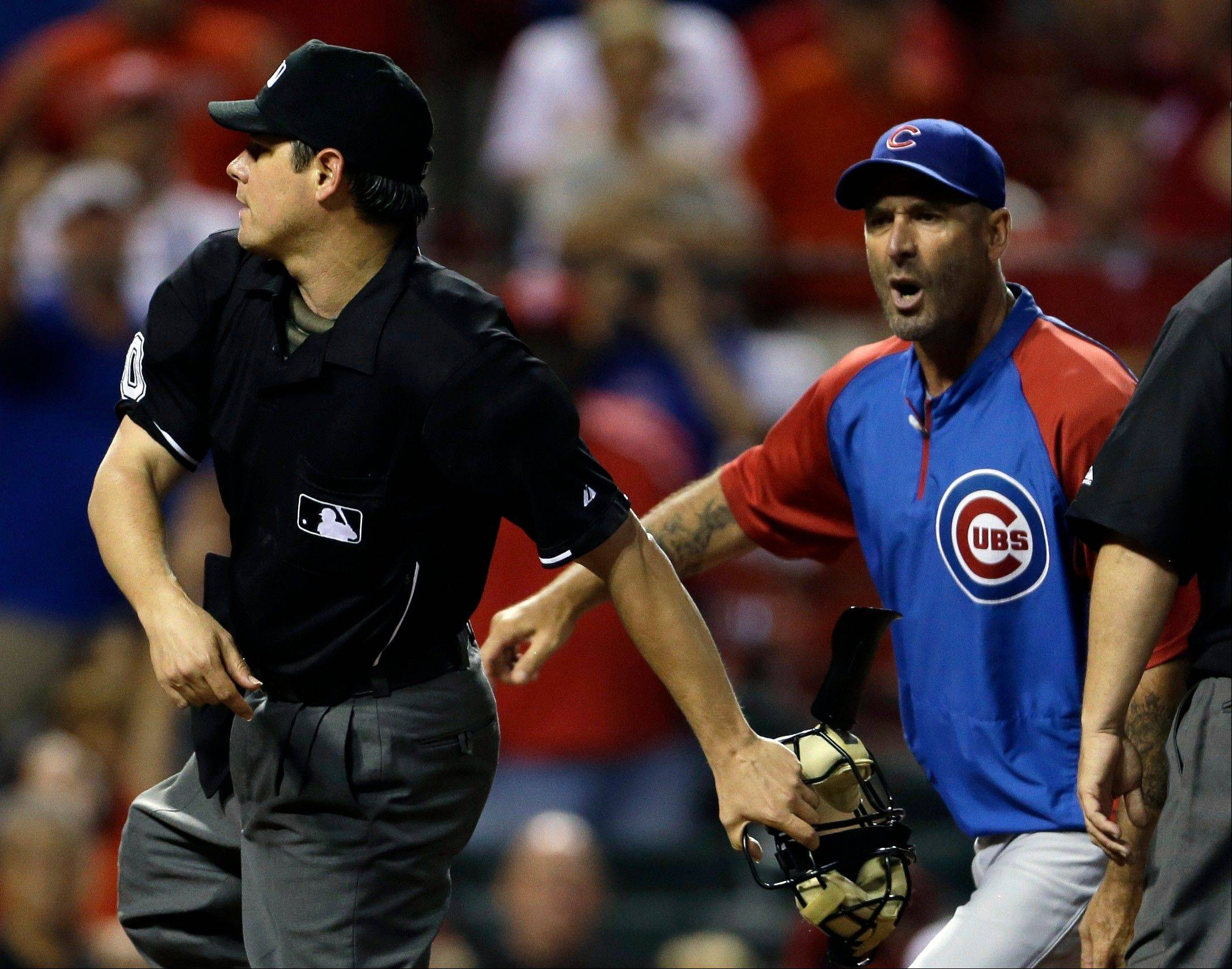 Chicago Cubs manager Dale Sveum, right, is thrown out by home plate umpire D.J. Reyburn during the seventh inning of a baseball game on against the St. Louis Cardinals on Monday, June 17, 2013, in St. Louis.