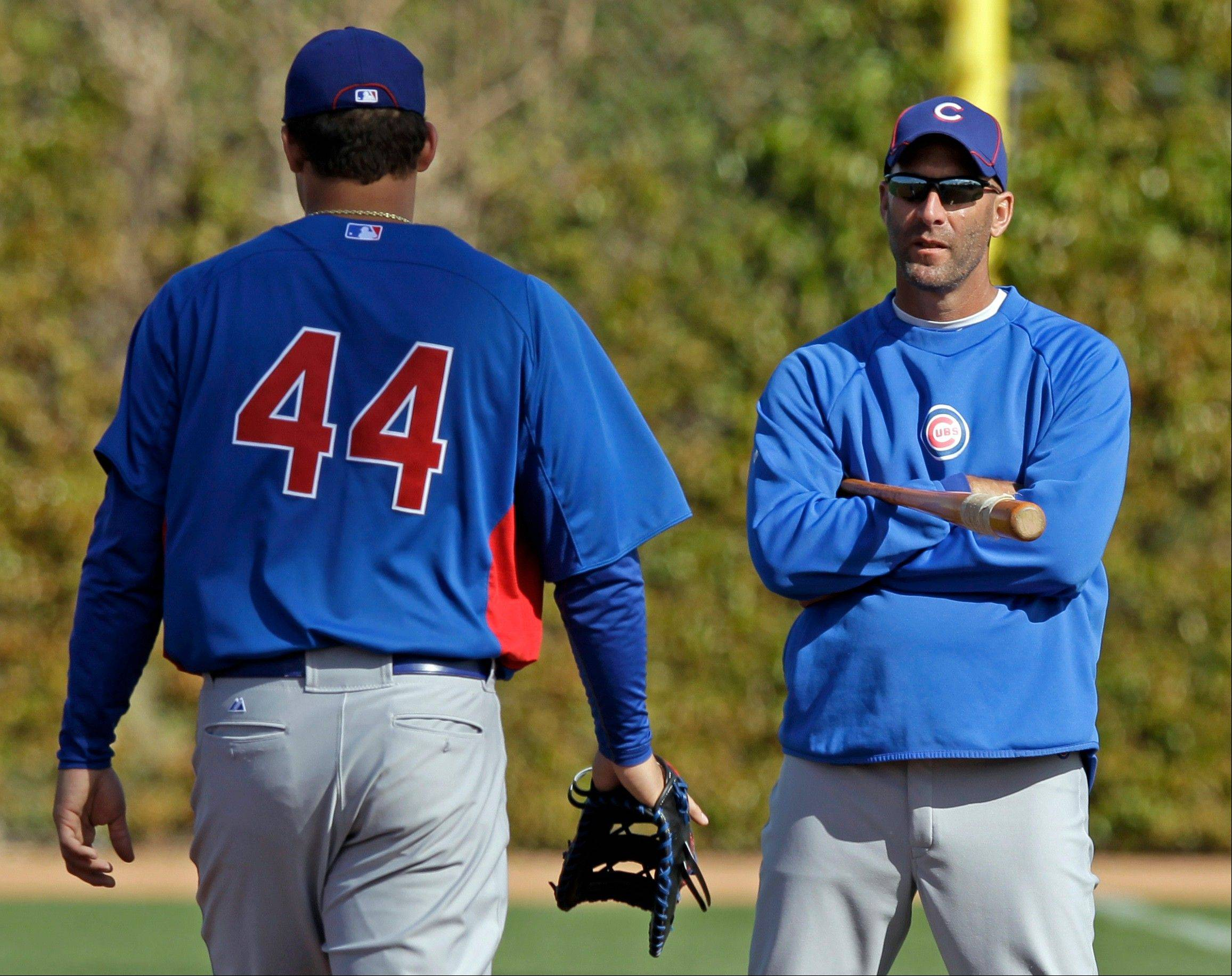 Chicago Cubs manager Dale Sveum, right, talks to Anthony Rizzo during a spring training baseball workout Tuesday, Feb. 28, 2012, in Mesa, Ariz.