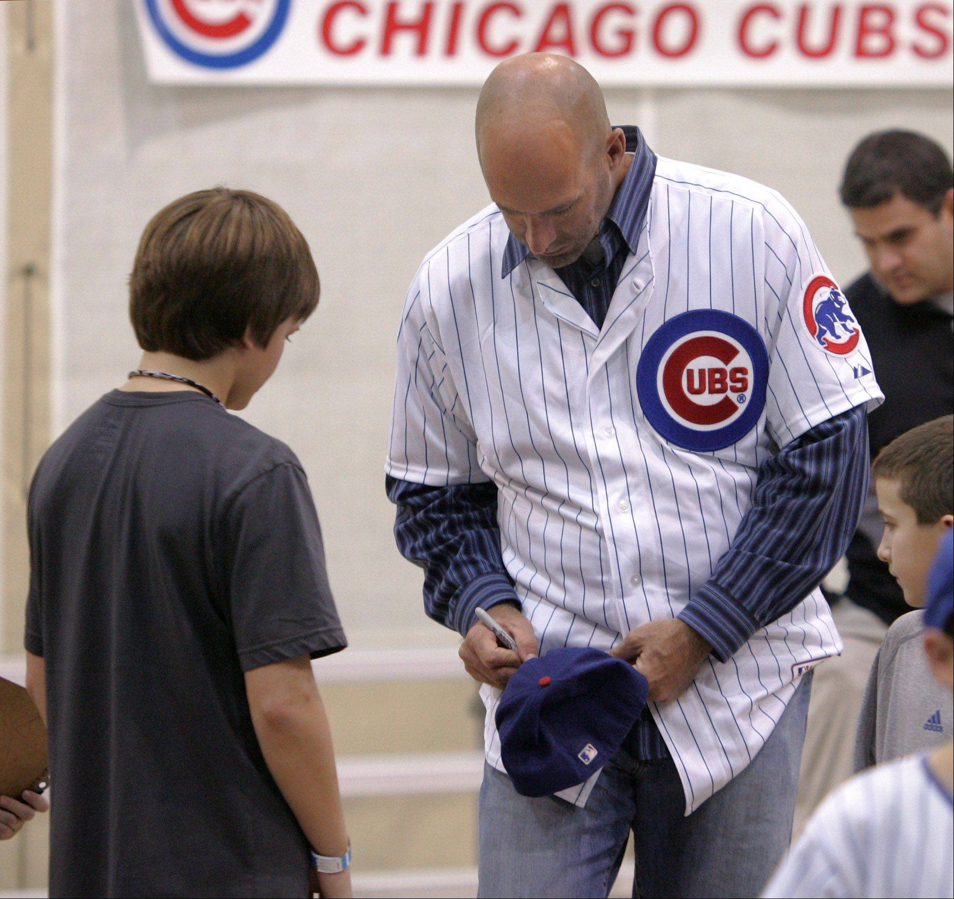 New Cubs manager Dale Sveum signs an autograph during a stop by the Chicago Cubs caravan Thursday as professional players and coaches from the team visit with little league players at the Libertyville Sports Complex.