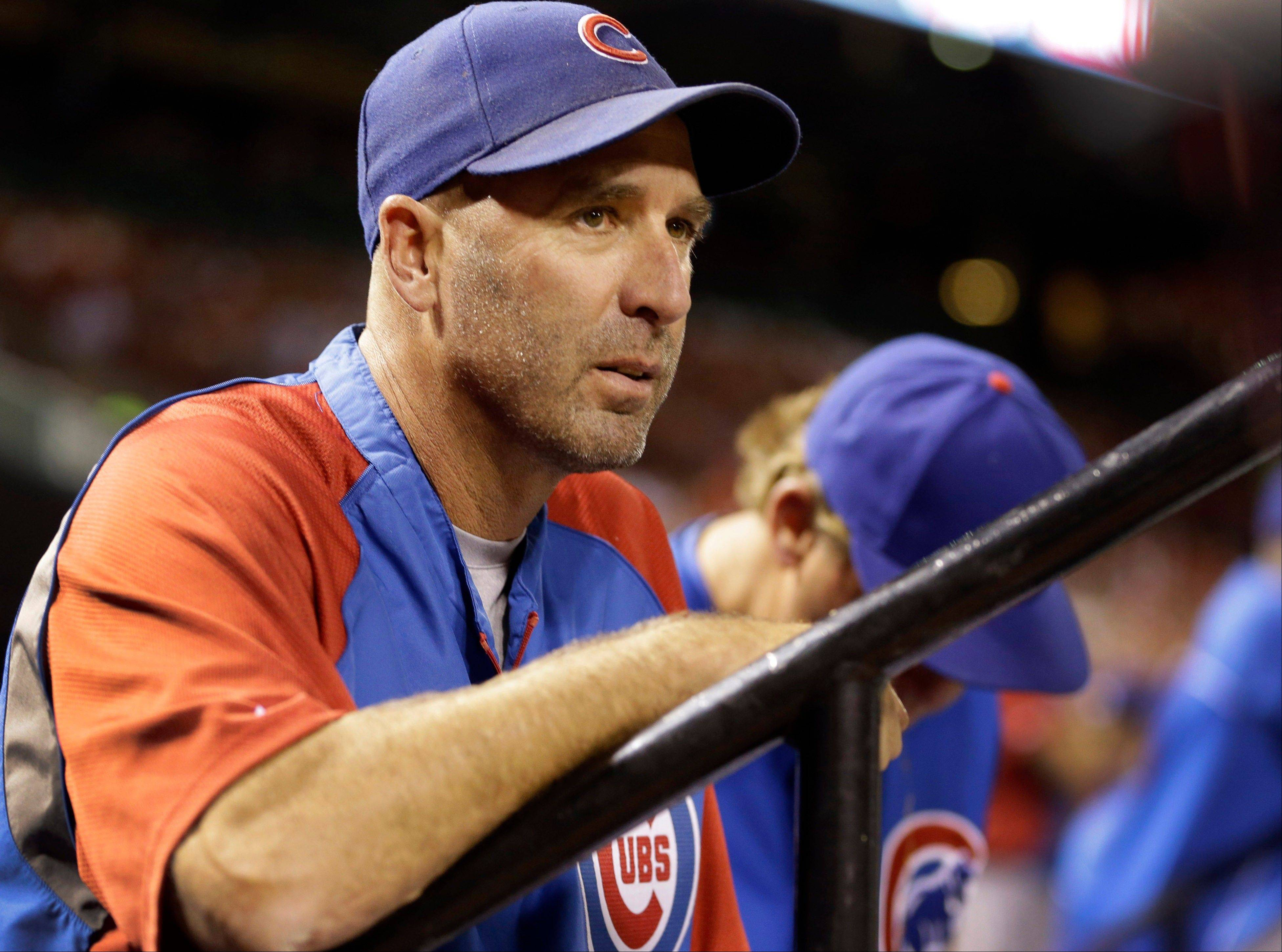 In this Sept. 27, 2013 file photo, Chicago Cubs manager Dale Sveum watches from the dugout during a baseball game against the St. Louis Cardinals in St. Louis. The Cubs fired Sveum on Monday, Sept. 30, 2013, after finishing last in the NL Central for the first time in seven years, ending a two-year run that produced more losses than any other in the team's cursed history.