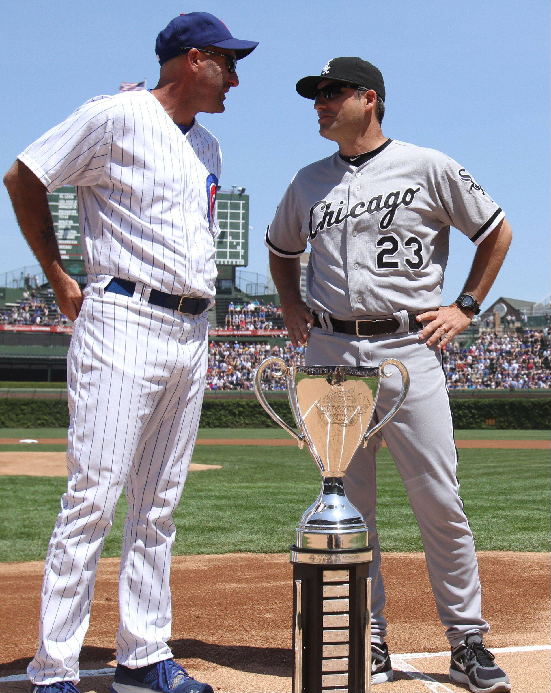 Chicago Cubs manager Dale Sveum and White Sox manager Robin Ventura pose with the BP cup before the teams play at Wrigley Field on Friday, May 18, 2012.
