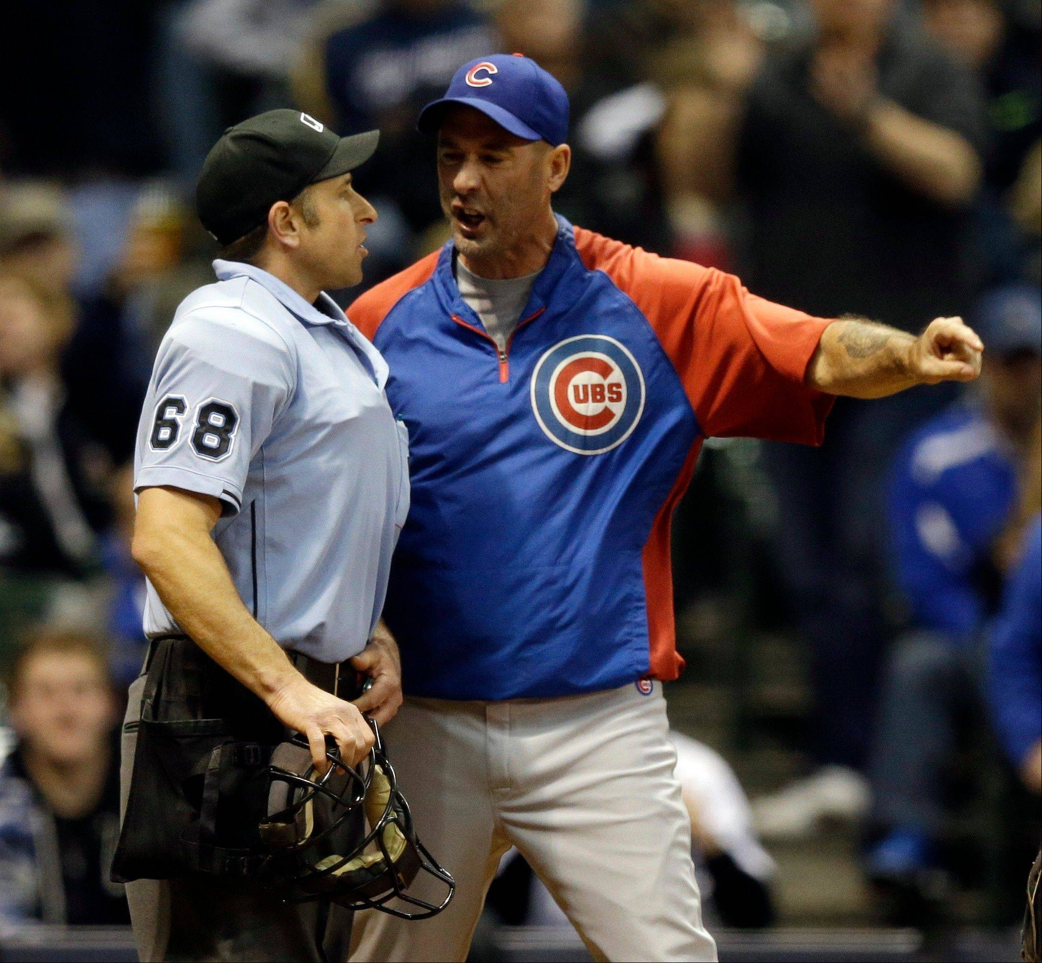 Chicago Cubs manager Dale Sveum, right, argues with home plate umpire Chris Guccione during the sixth inning of a baseball game against the Milwaukee Brewers, Friday, April 19, 2013, in Milwaukee. Sveum was ejected from the game.