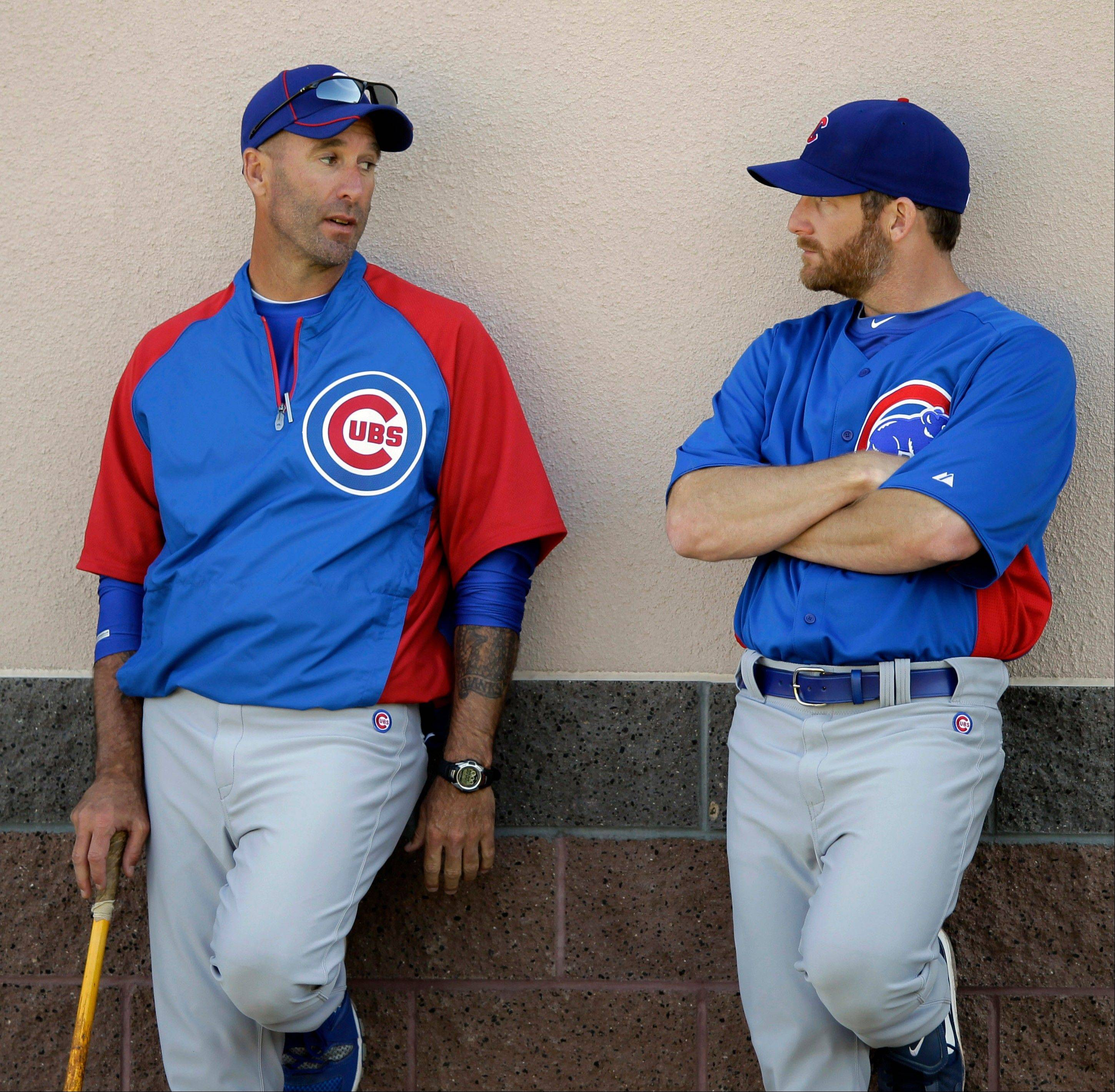 Chicago Cubs manager Dale Sveum, left, talks to pitcher Ryan Dempster during a spring training baseball workout, Tuesday, Feb. 21, 2012, in Mesa, Ariz.