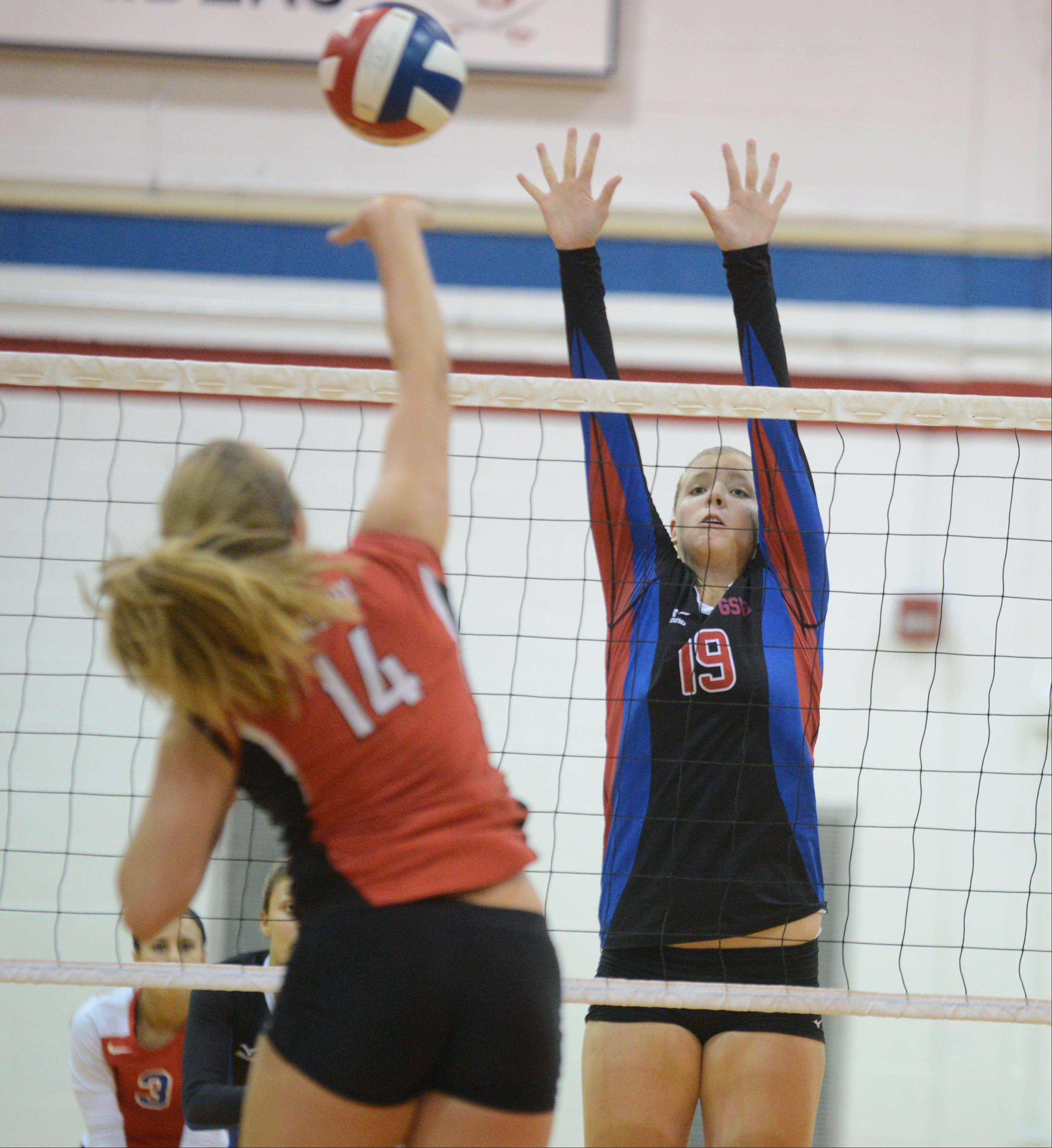 Kacie Stoll of Timothy Christian and Sydney Bauman of Glenbard South girls volleyball action Tuesday in Glen Ellyn.