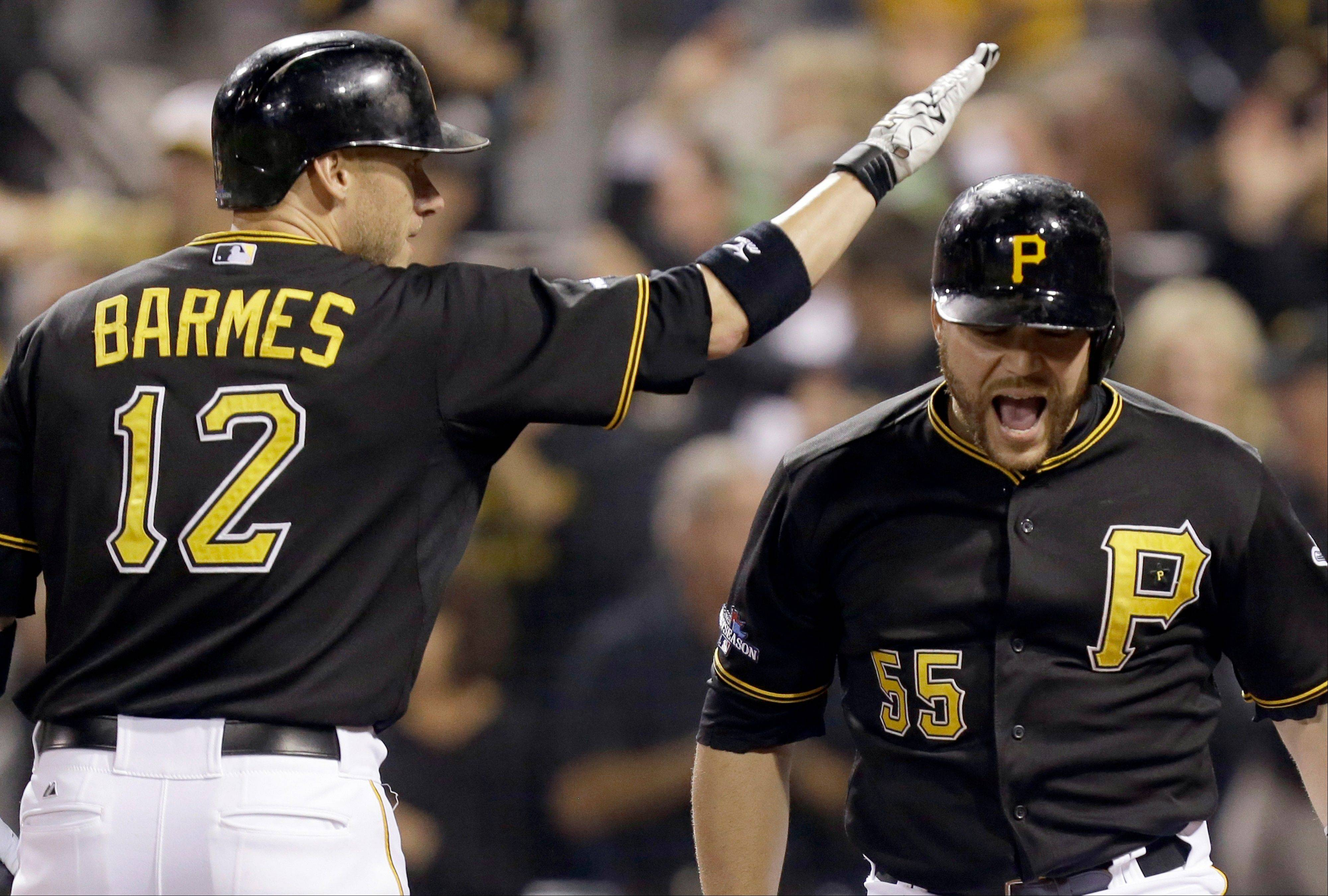Pittsburgh Pirates' Russell Martin (55) is greeted by on-deck batter Clint Barmes (12) after hitting a home run in the second inning of the NL wild-card playoff baseball game against the Cincinnati Reds on Tuesday, Oct. 1, 2013, in Pittsburgh. (AP Photo/Gene J. Puskar)