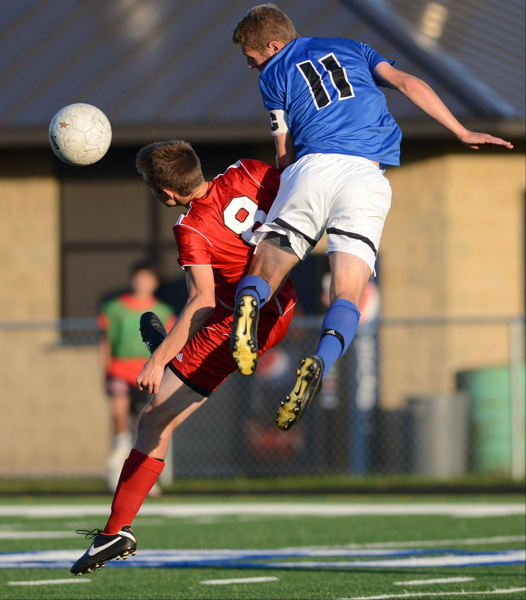 St. Charles North�s Phillip Legare wins a header over Batavia�s Brendan Allen during Tuesday�s action at the Tri-Cities boys soccer challenge in Geneva.