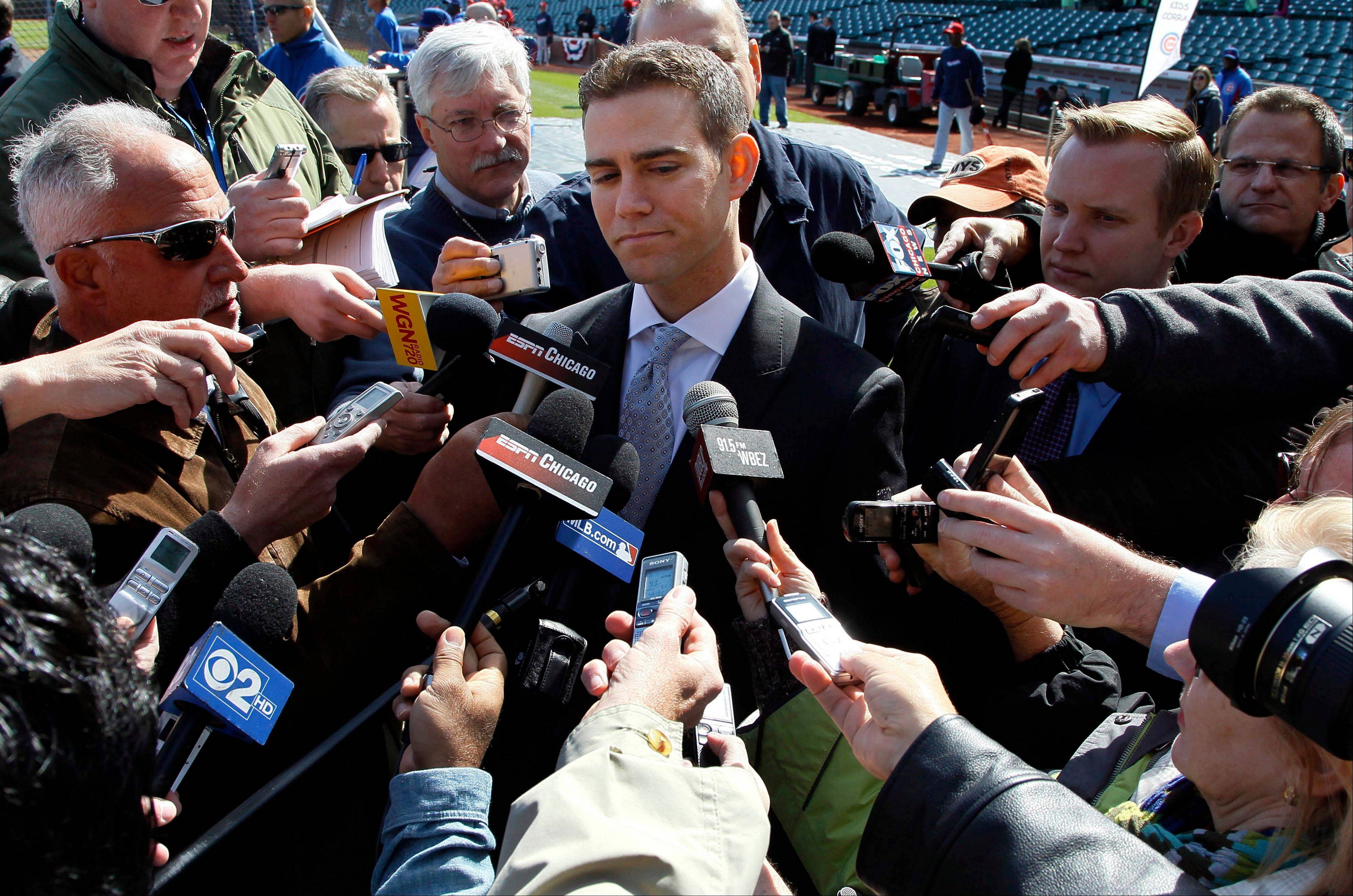 For now, media interviews with managerial prospects won't be part of the search process, according to Cubs president Theo Epstein, center. In 2011, managerial candidates were paraded before Chicago media to see how they could handle a news conference.