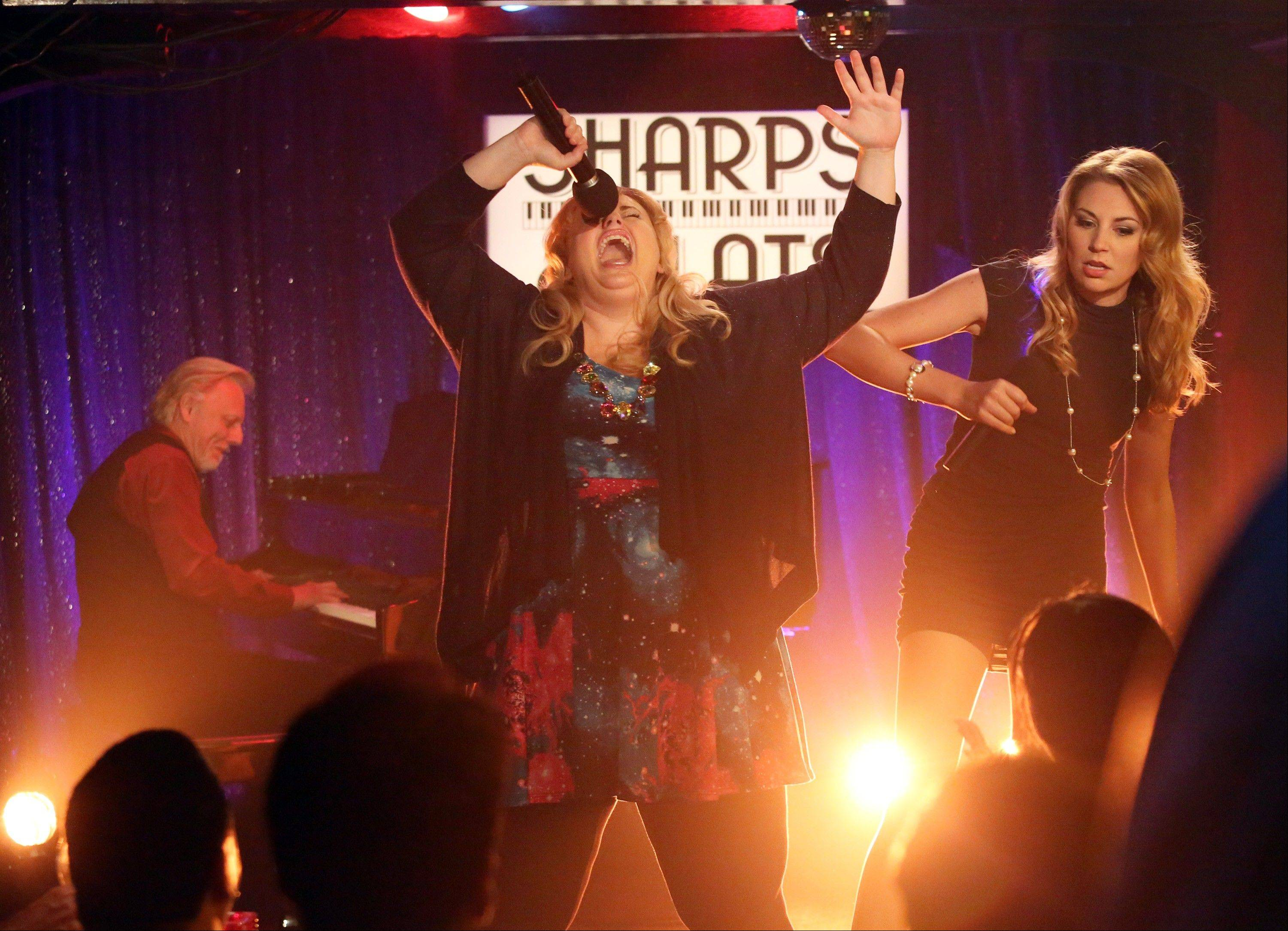 "Rebel Wilson, center, and Kate Jenkinson go a little crazy in ""Super Fun Night,"" which premieres at 8:30 p.m. Wednesday, Oct. 2, on ABC."