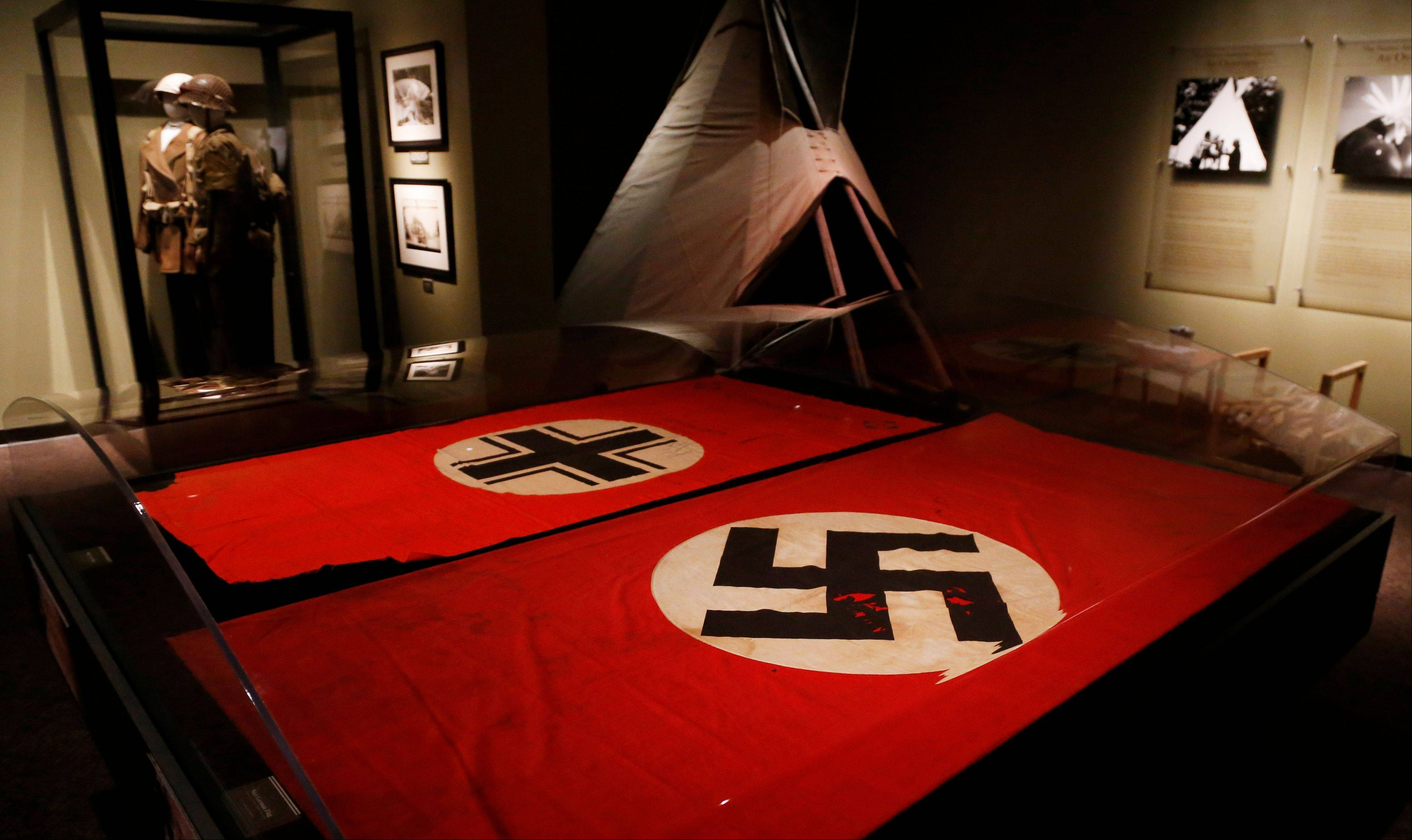 The Baltic Cross, left, captured by Comanche Code Talker Larry Saupitty and a Nazi German flag captured by Code Talker Charles Chibitty are on display.at the Comanche National Museum and Cultural Cente.