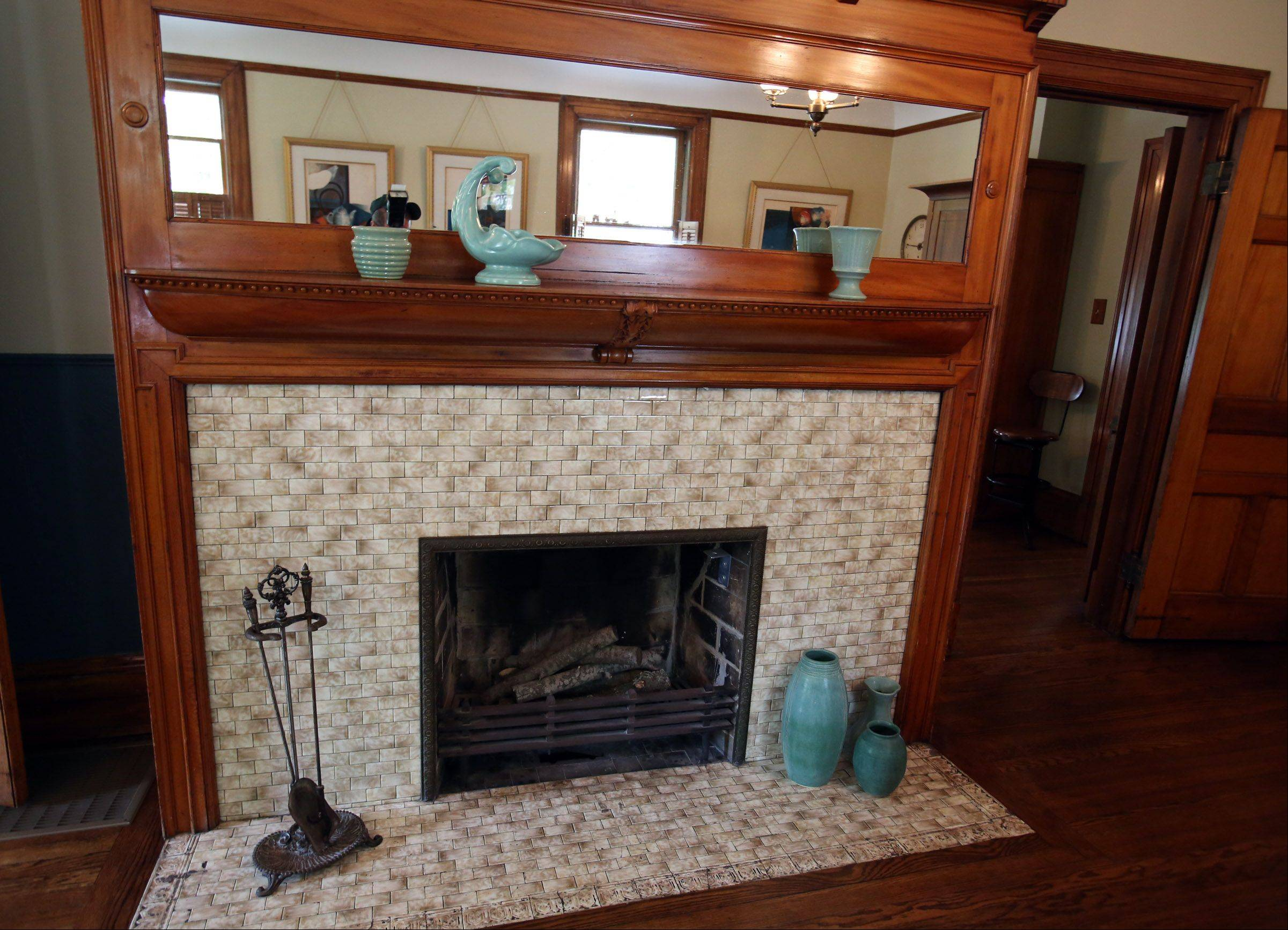 The living room fireplace in Laura and Michael Thompson's Oak Park home shows the skill of 19th century carpenter Abraham Edmunds.