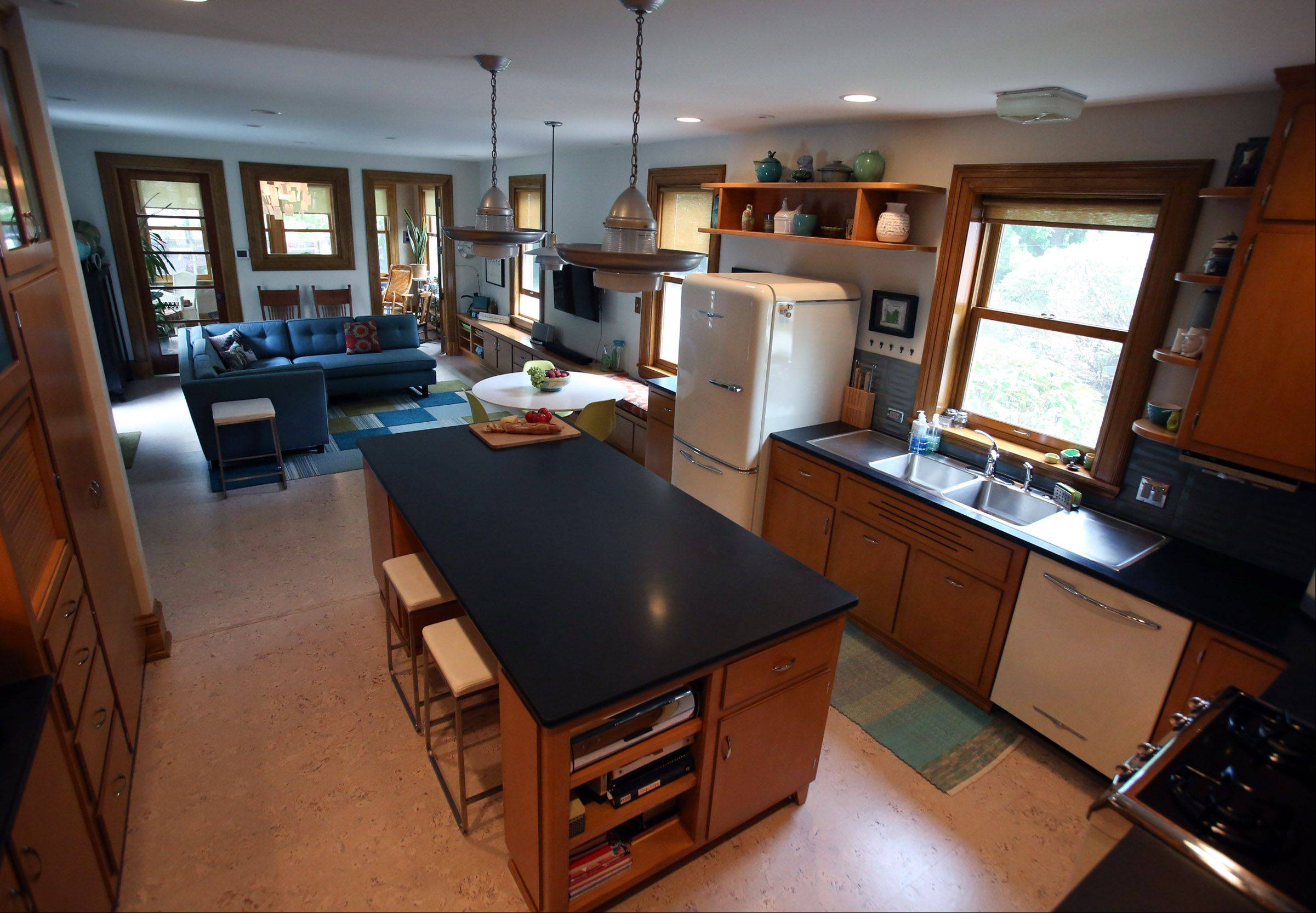 The Thompsons remodeled their kitchen and added a family room.