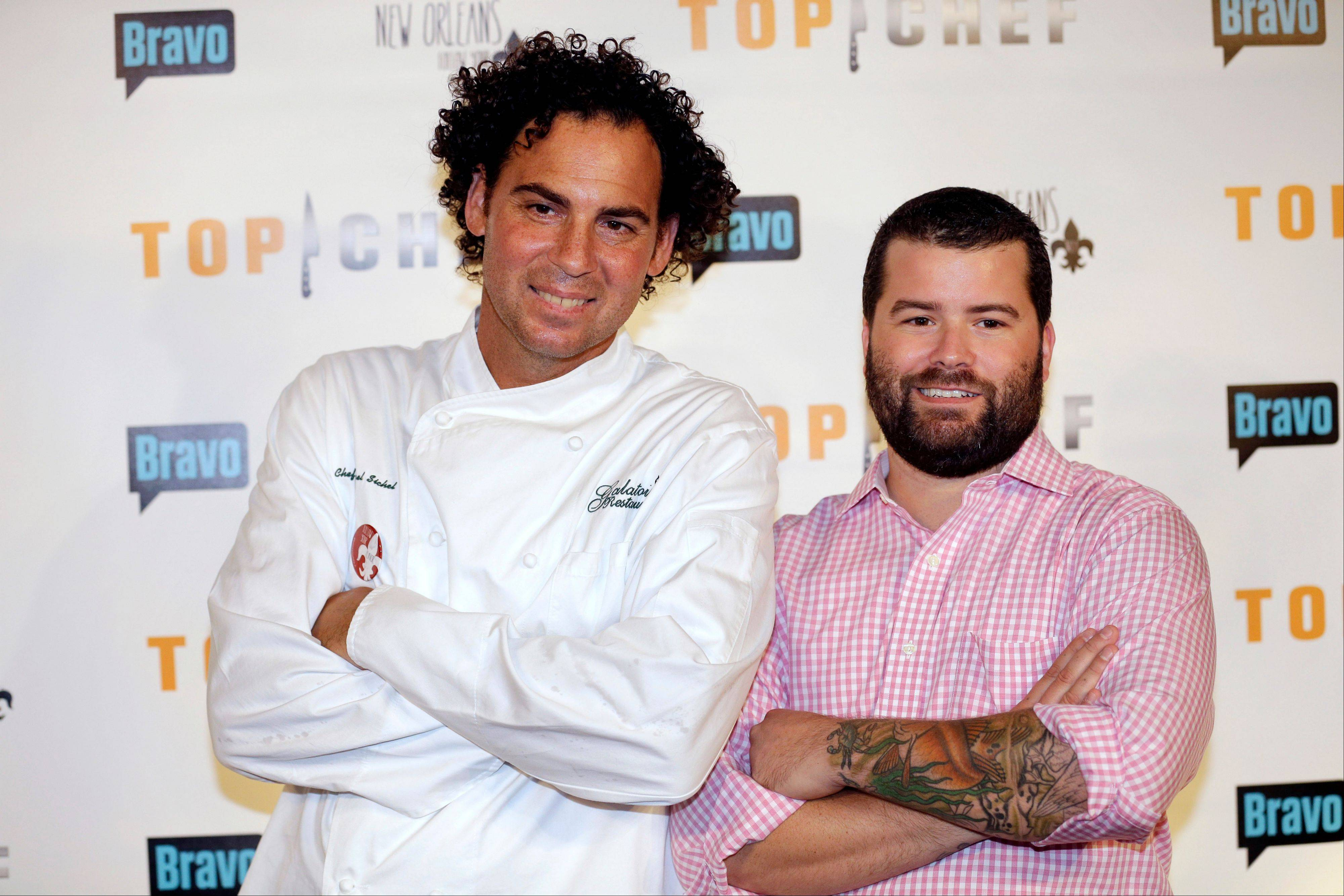 "Contestants Michael Sichel, left, executive chef at Galatoire's Restaurant, and Justin DeVillier, executive chef at La Petite Grocery, arrive at a red carpet event for the Bravo TV series ""Top Chef"" in New Orleans."