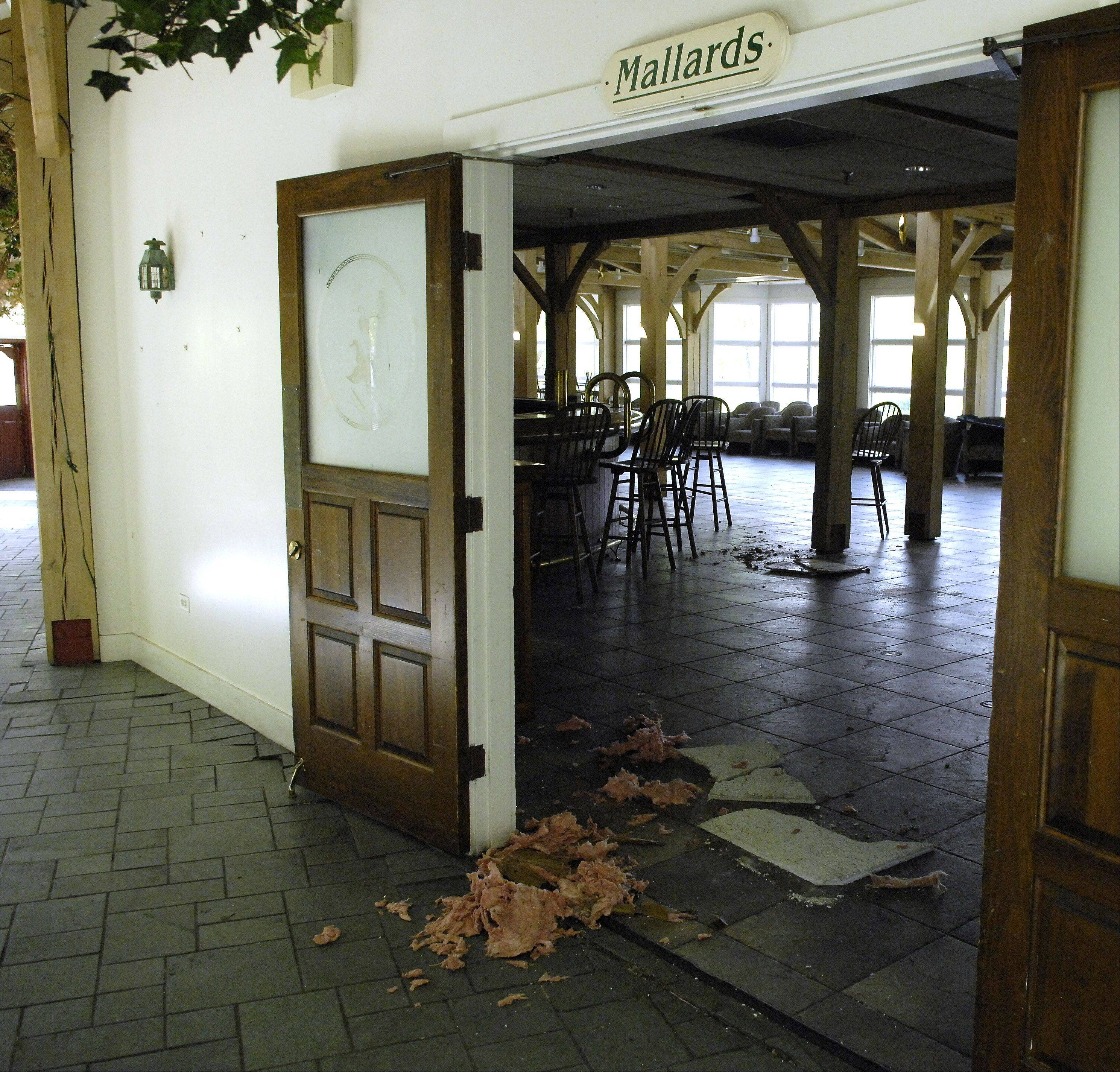 Ceiling tiles at the Mill Race Inn are chewed up and on the floor, possibly as a result of a group of raccoons that city officials believe may be inhabiting the attic of the vacant building.