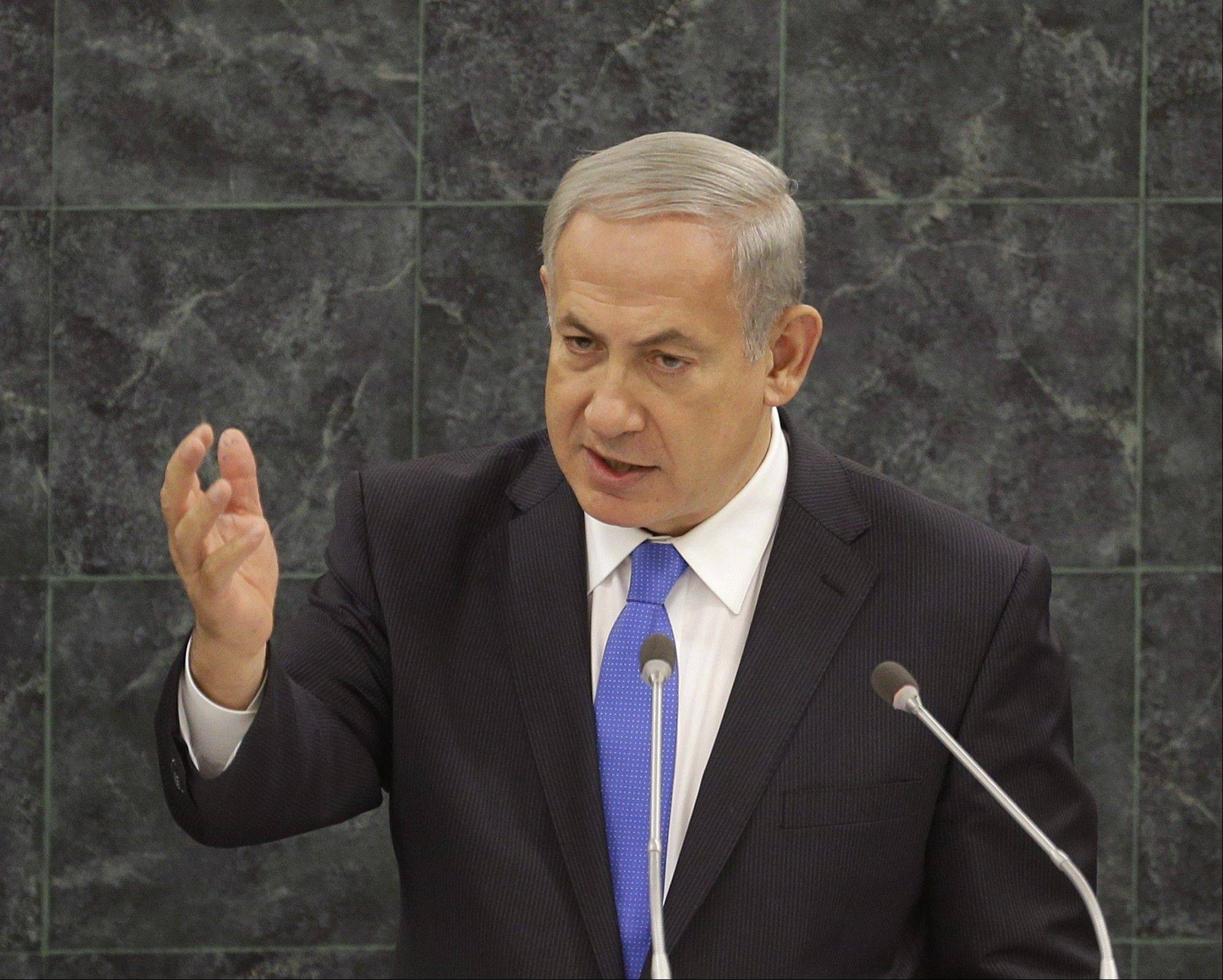 "Israeli Prime Minister Benjamin Netanyahu, speaking before the U.N. General Assembly on Tuesday, declared his country will never allow Iran to get nuclear weapons, even if it has to act alone. He dismissed the Iranian president's ""ch"