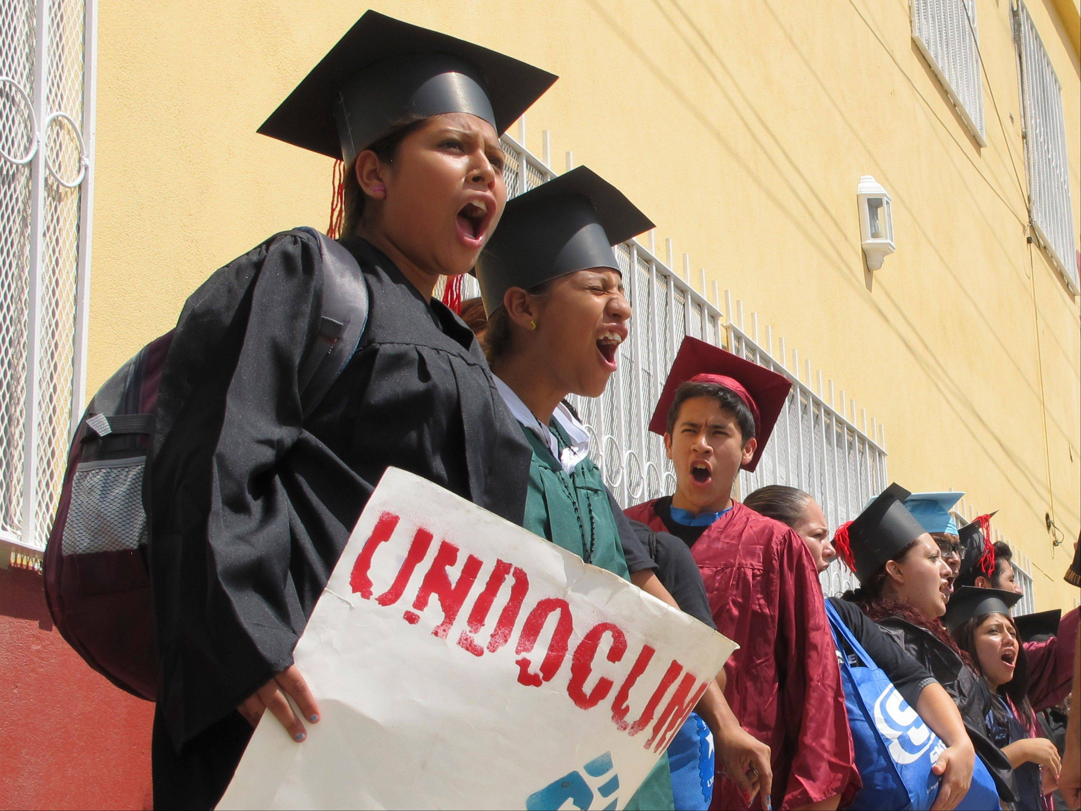 "Wearing a colorful array of graduation-style caps and gowns, 34 young people who spent long stretches of their childhoods in U.S. cities like Phoenix and Boston chanted ""undocumented and unafraid"" as they crossed the Rio Grande into Texas."