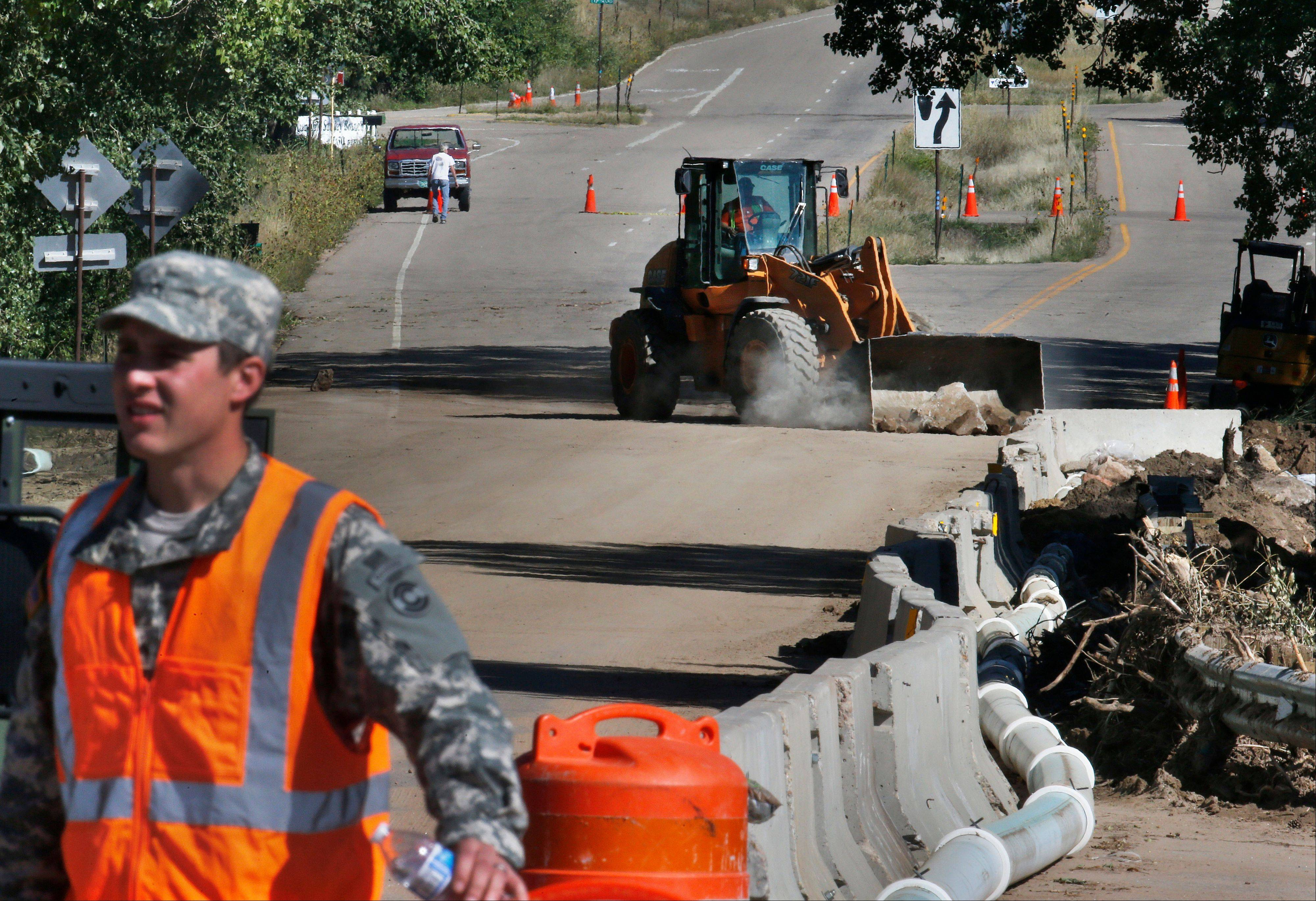 The partial federal government shutdown that started Tuesday has left hundreds of thousands of federal workers without paychecks and shut down federal services all over the country. National Guard soldiers rebuilding washed-out roads in Colorado would apparently be paid on time -- along with the rest of the country's active-duty personnel -- under a bill passed hours before the shutdown.