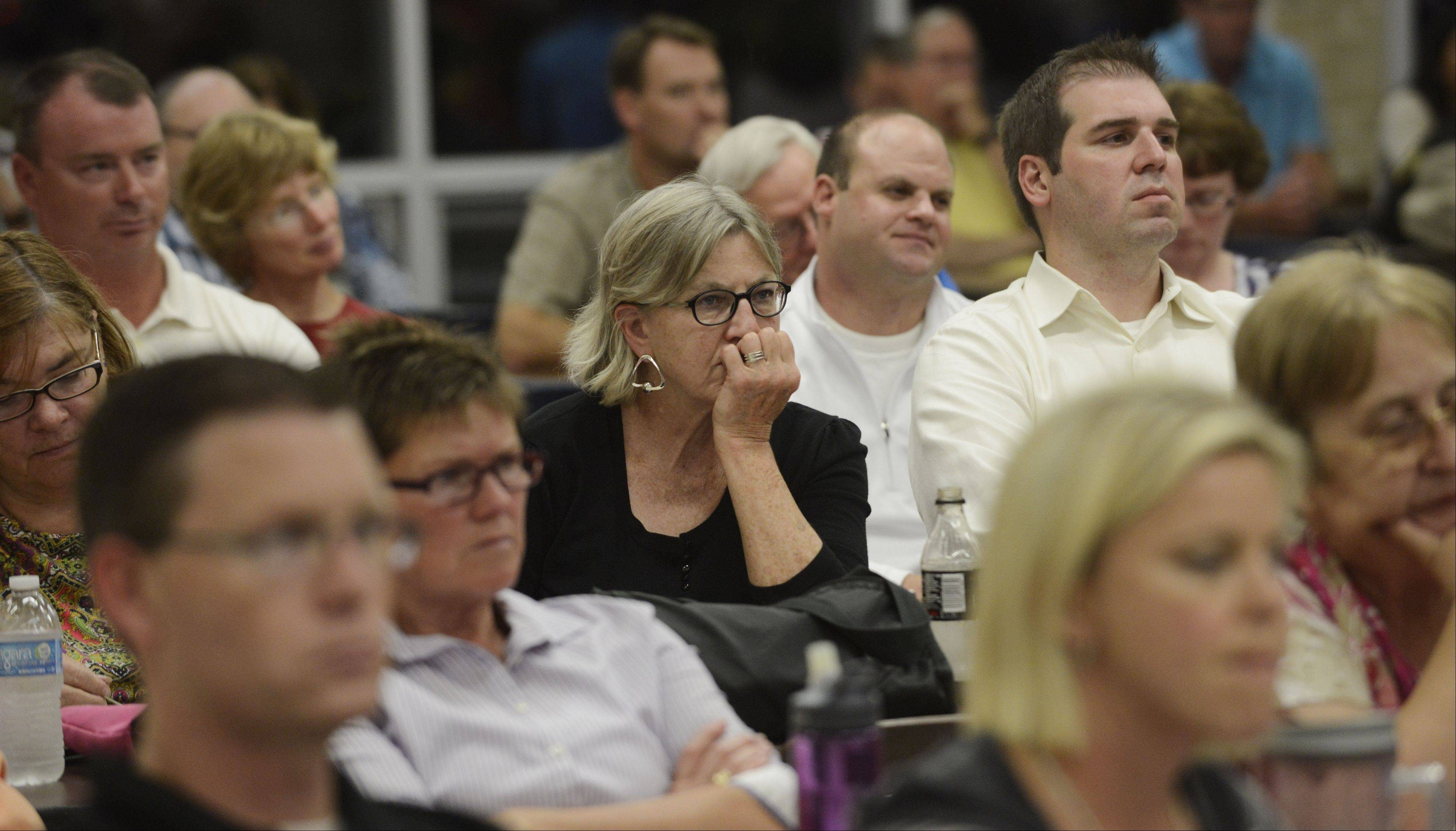 JOE LEWNARD/jlewnard@dailyherald.comResidents listen during the Wauconda Village Board meeting Tuesday, which had been moved to Wauconda High School because of the large number of people in attendance.