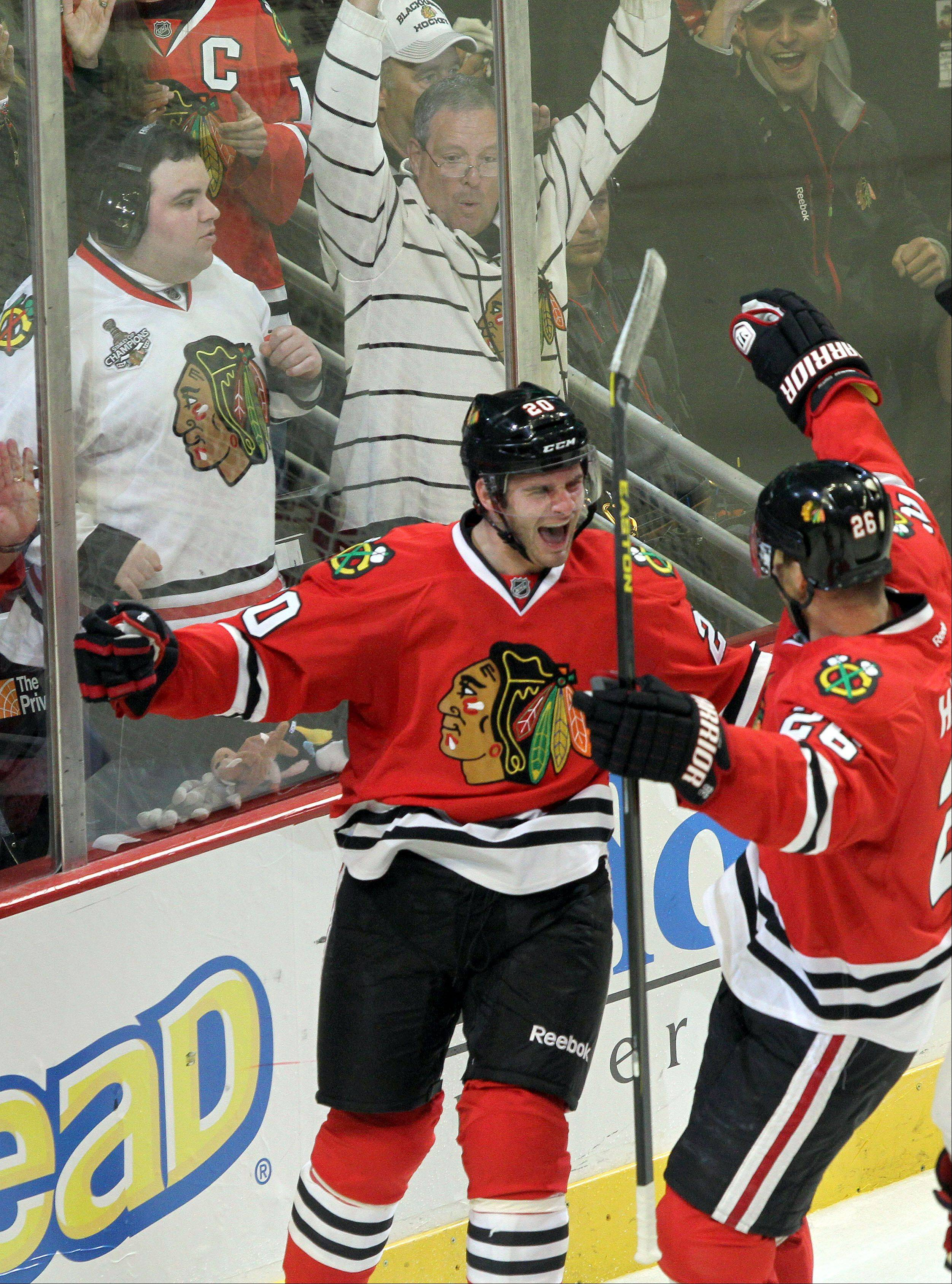 Steve Lundy/slundy@dailyherald.com Chicago Blackhawks left wing Brandon Saad celebrates with Chicago Blackhawks center Michal Handzus after Saad's 3rd period goal during their opening-day-game Tuesday at the United Center in Chicago.