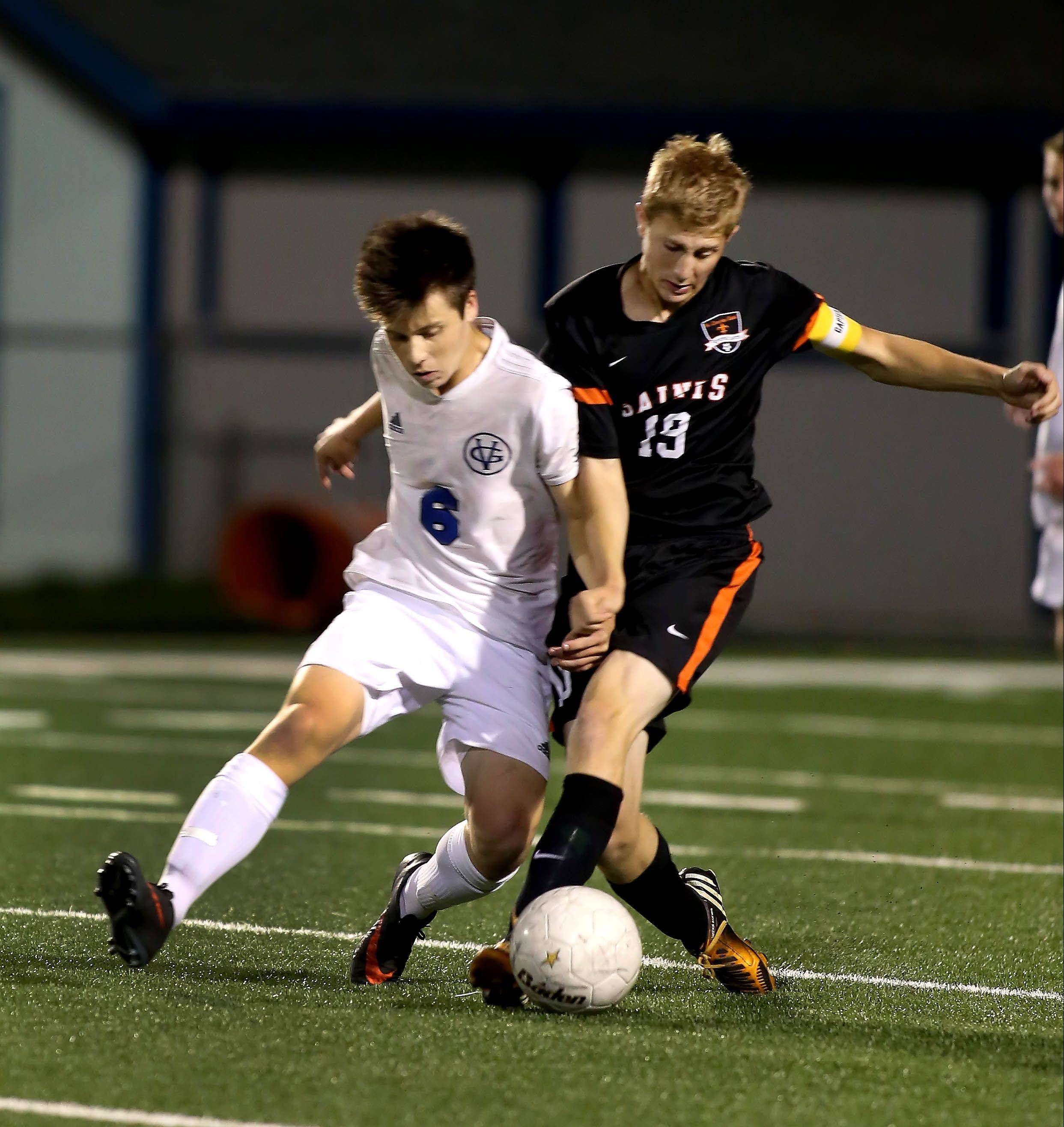 Calen Colbert of Geneva, left, and Andrew Shone of St. Charles East, right, in action for the ball during Tri-Cities boys soccer in Geneva on Tuesday.